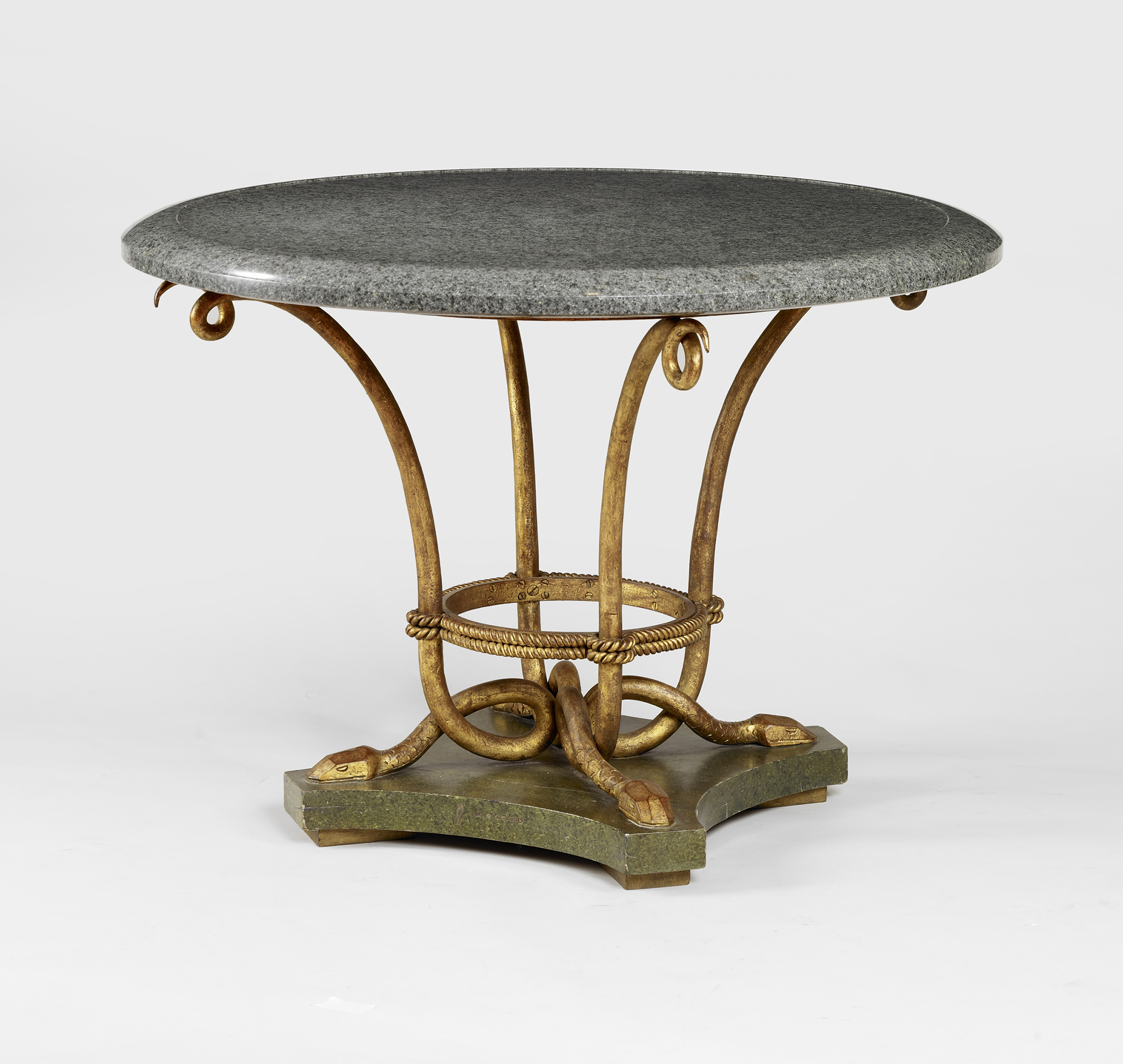 Rare Art Deco table by Marcel Coard, 1940 gilded wrought iron snake-shaped legs and marble top, standing on a quadrangular marble-effect wood base, 108 x 78 cm  Courtesy of Robert Zehil Gallery