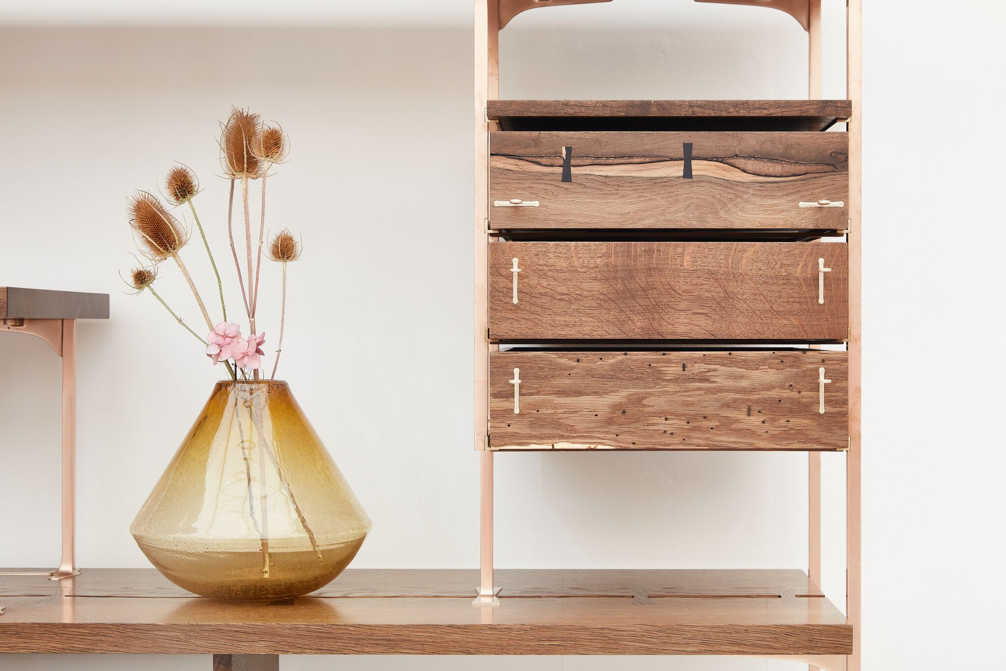 Detail of Shelving Unit in Scottish Oak with solid bronze structure on display at Decorex international 2018 © roozphoto