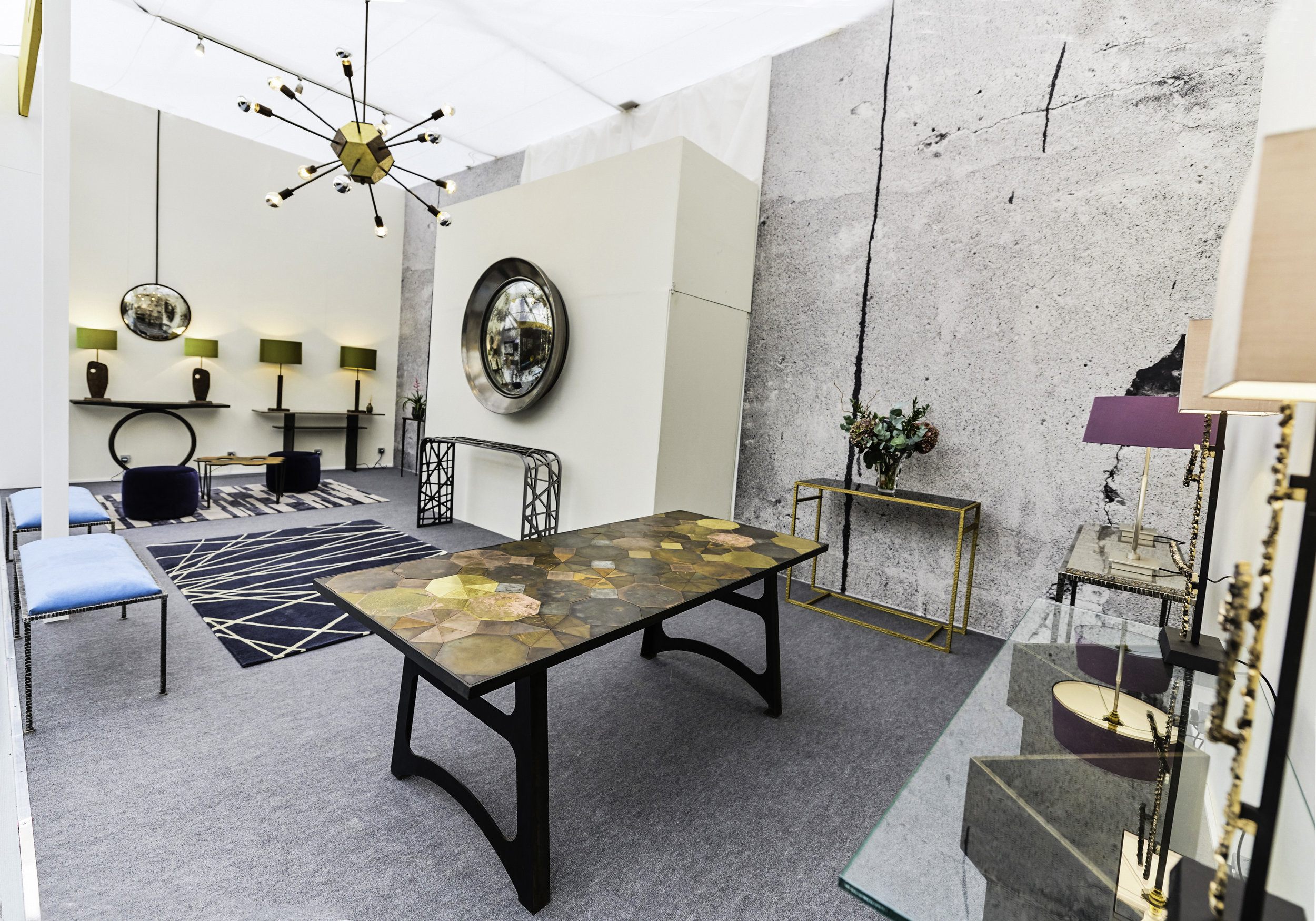 Blackbird Bespoke at Decorex International 2018; on display  Mosaic dining table  (centre),  Birds Nest  console table and  Luna Mirror  (far right),  Hepworth  table lamps (far left) and TO1 chandelier ©Blackbird Bespoke