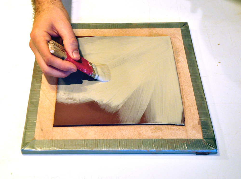 PHOTO A: Applying slip to leather hard clay