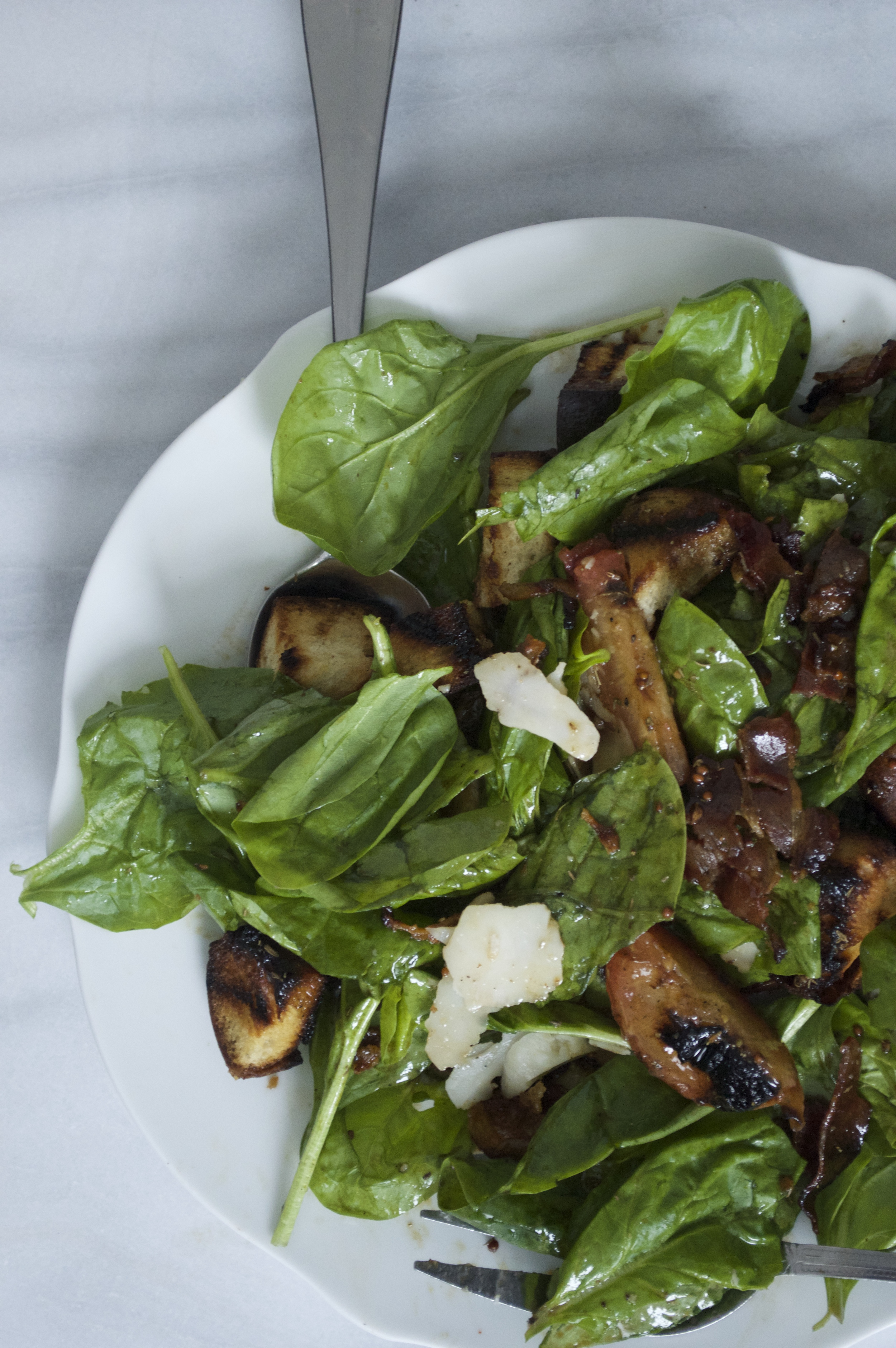 spinach-salad-grilled-plums-challah-croutons-goat-gouda.jpg