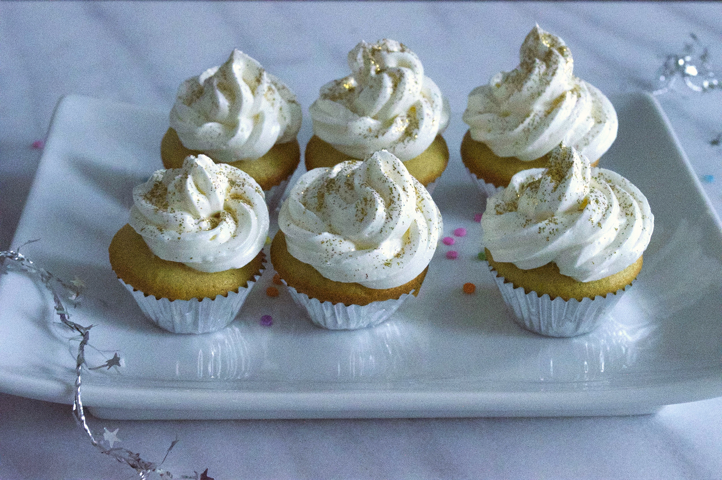 champagne-cocktail-cupcakes-plate-of-6-side-view-molasses-and-mayhem.jpg