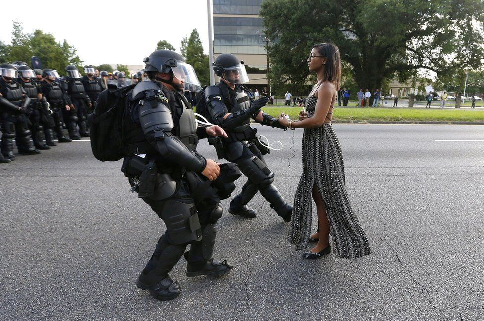 """Powerful"" is how photographer Jonothan Bachman described protester Ieshia Evans. I find this image powerful on so many different levels.  The more I look at the image the more I find, the more I examine, the more I question, which is exactly what the most powerful photography does.   Evans is detained by law enforcement as she protests the shooting death of Alton Sterling near the headquarters of the Baton Rouge Police Department in Baton Rouge, La., on July 9, 2016."
