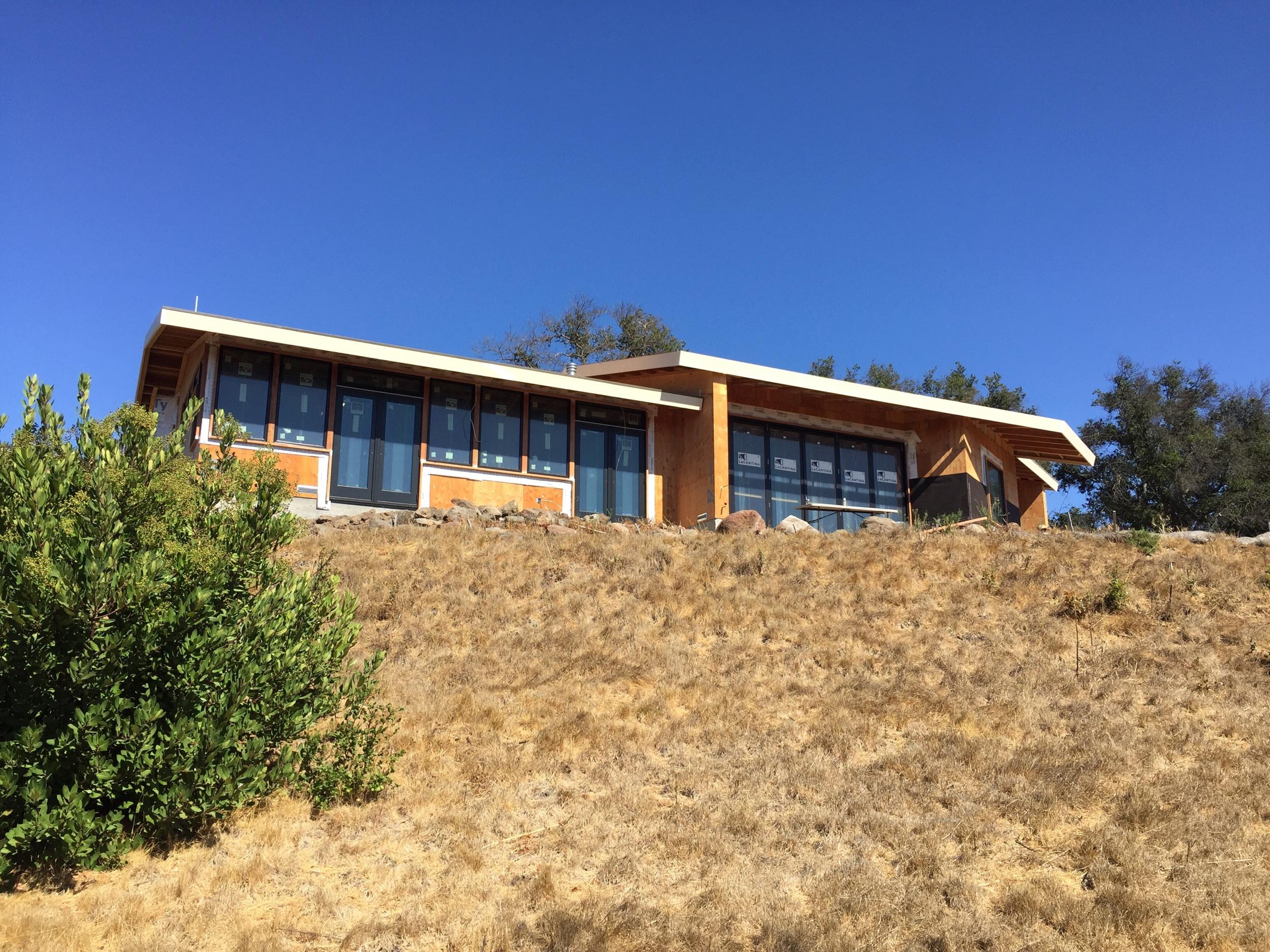 From the hillside below