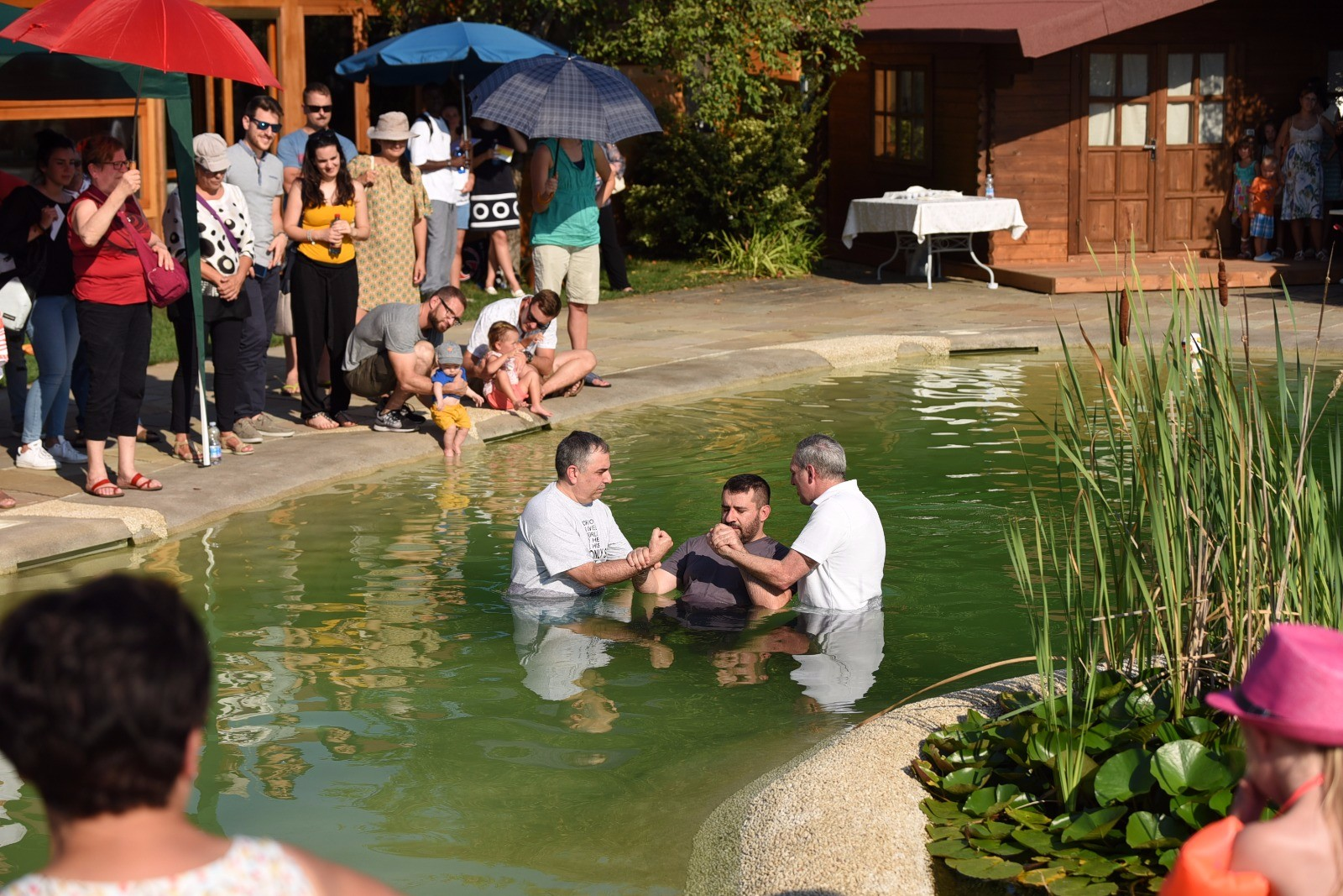 July 29, 2018: Daniele is pictured here being baptized by his pastor and discipler, Antonio, on one of the hottest days of the year.