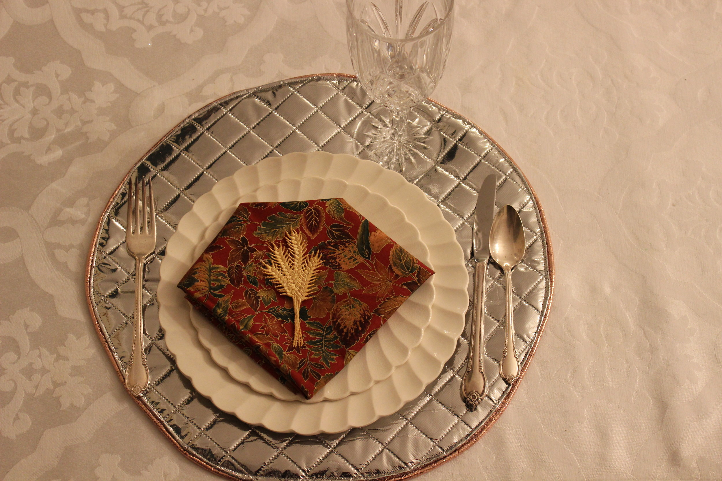 """Plates from the restaurant owned by Henry Ford. Freestanding """"Harvest Wheat"""" design by Sonia Showalter."""