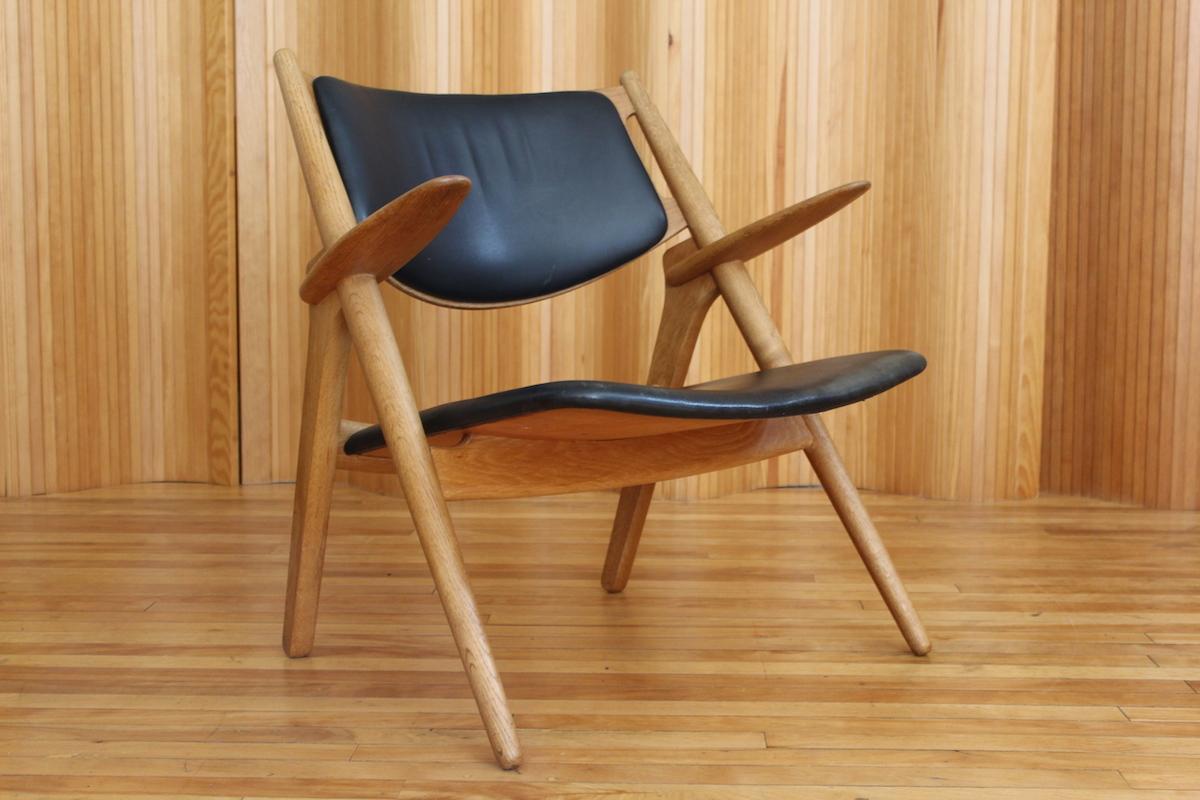 Hans Wegner CH28 'Sawbuck' lounge chair - Carl Hansen & Son, Denmark, 1952.