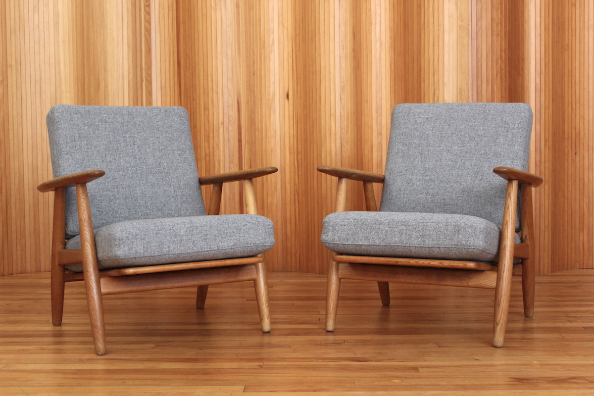 Pair of Hans Wegner oak 'cigar' lounge chairs Getama Denmark