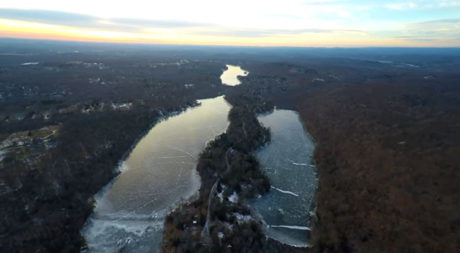 Feb 2015 photo taken by drone camera operated by Peter Treyz.  Lake Waccabuc is at the center top of the photo.
