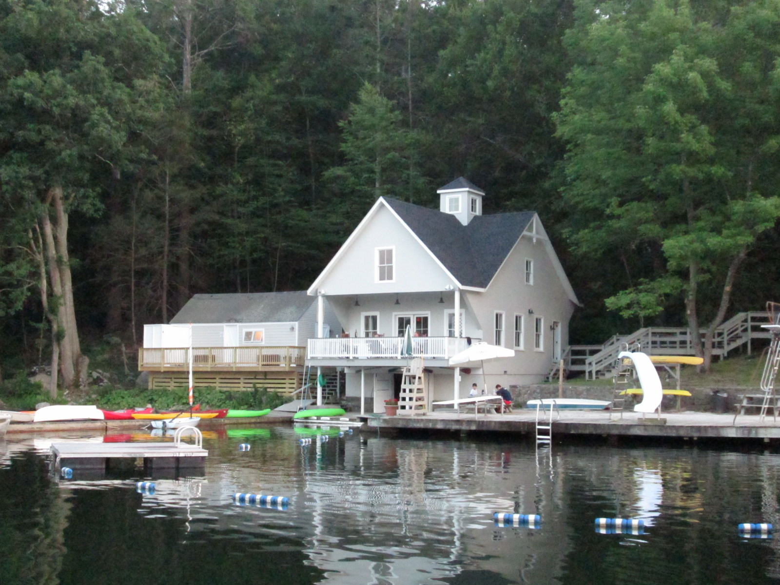 2016 photo of the Waccabuc Country Club's boathouse at their beachfront on the lake