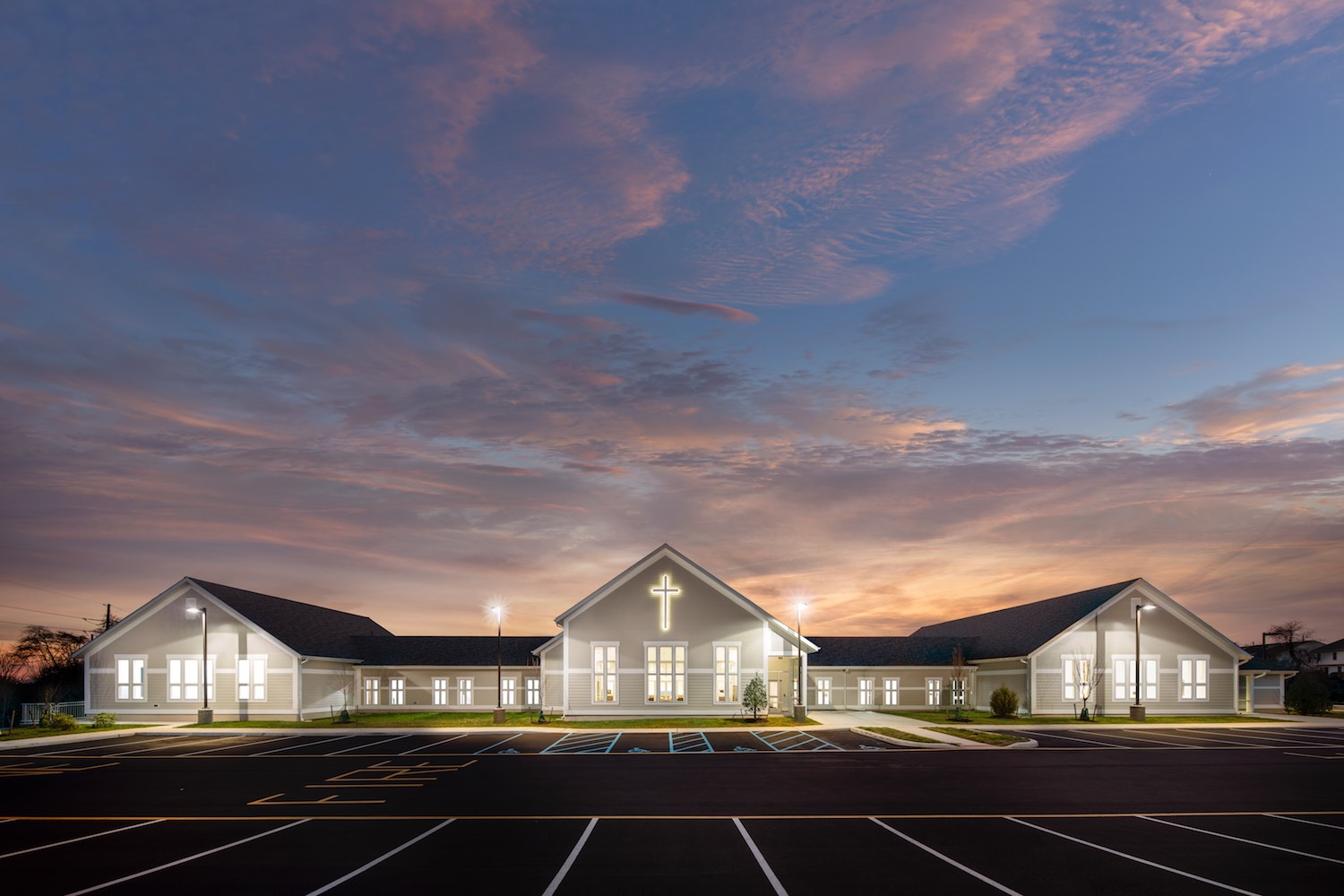 """Twilight images don't need direct sun and often show off the building brilliantly. This one was done as an elevation, probably very close to the way the design appeared on the """"blueprints"""" when the design was being worked up."""