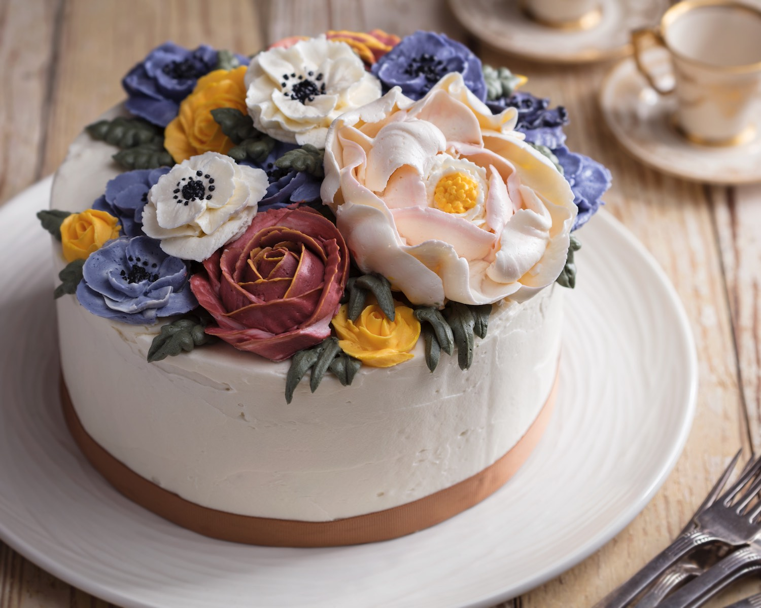Of all of the images this might be my favorite, it really shows off the cake without too much else. I think the props do a nice job thematically.