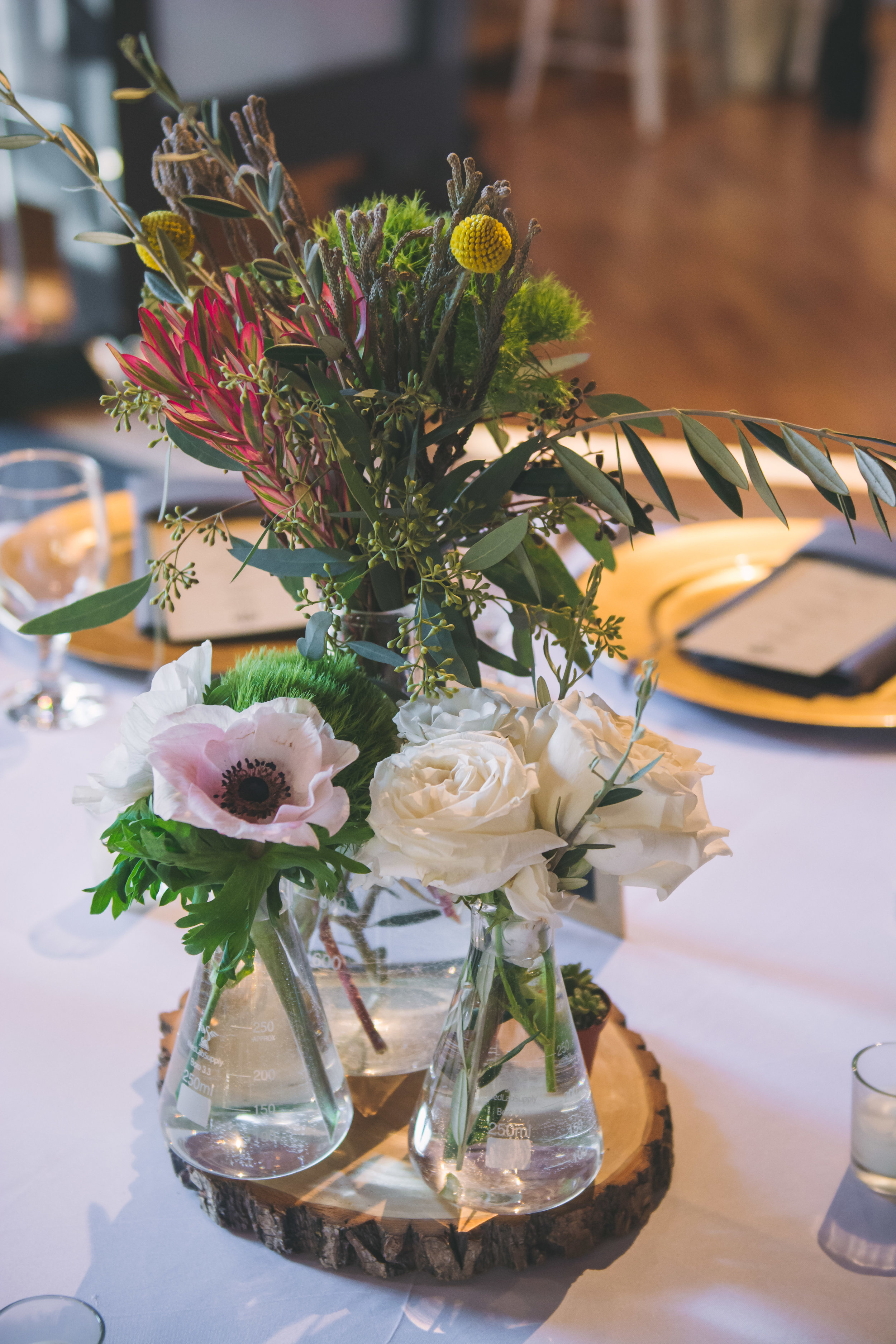 Fresh wildflowers adorned each table in beakers and flasks as an ode to the brides nursing profession.