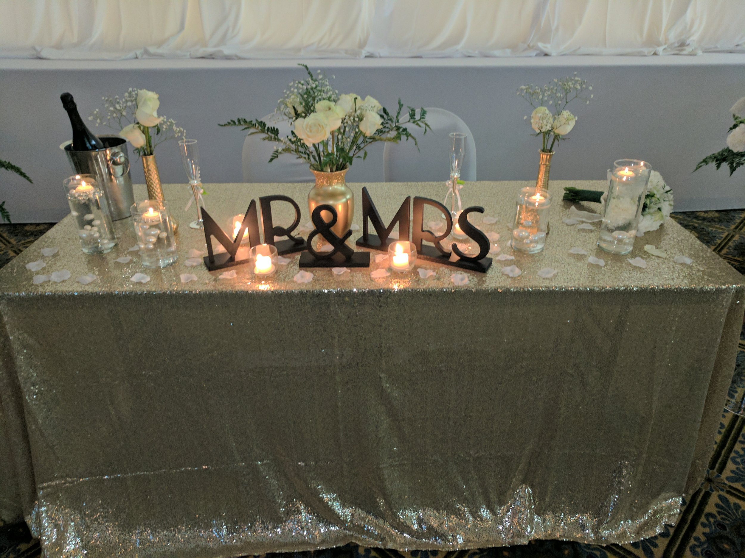 A closer shot of their sweetheart table details that complimented the Great Gatsby Theme