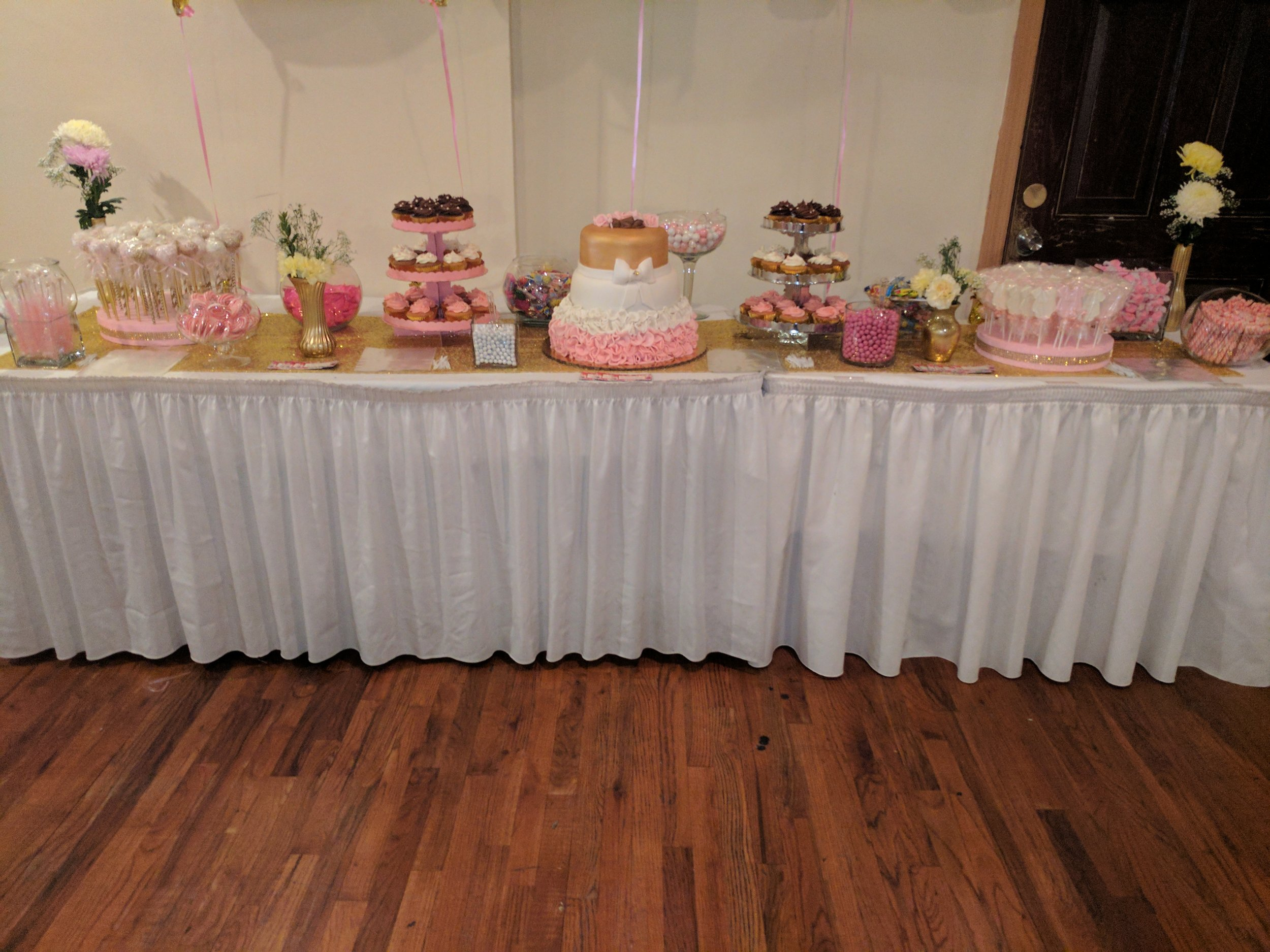Lovely pink and gold candy/dessert table styled by Raquel