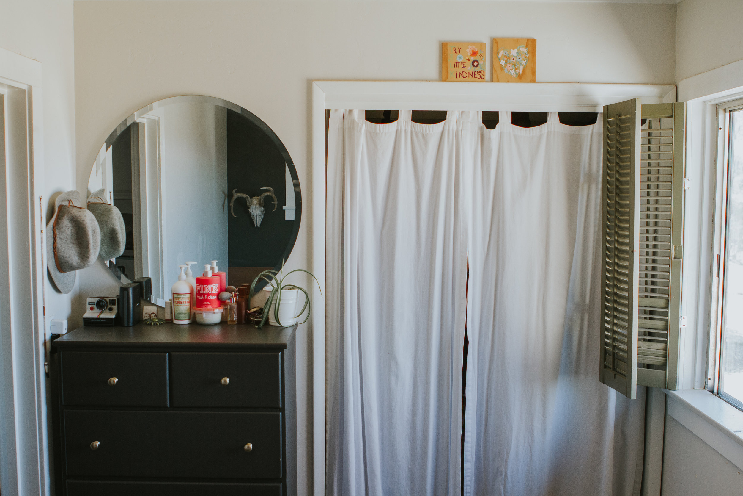 We replaced the closet doors with curtains to make it look a little less confined.