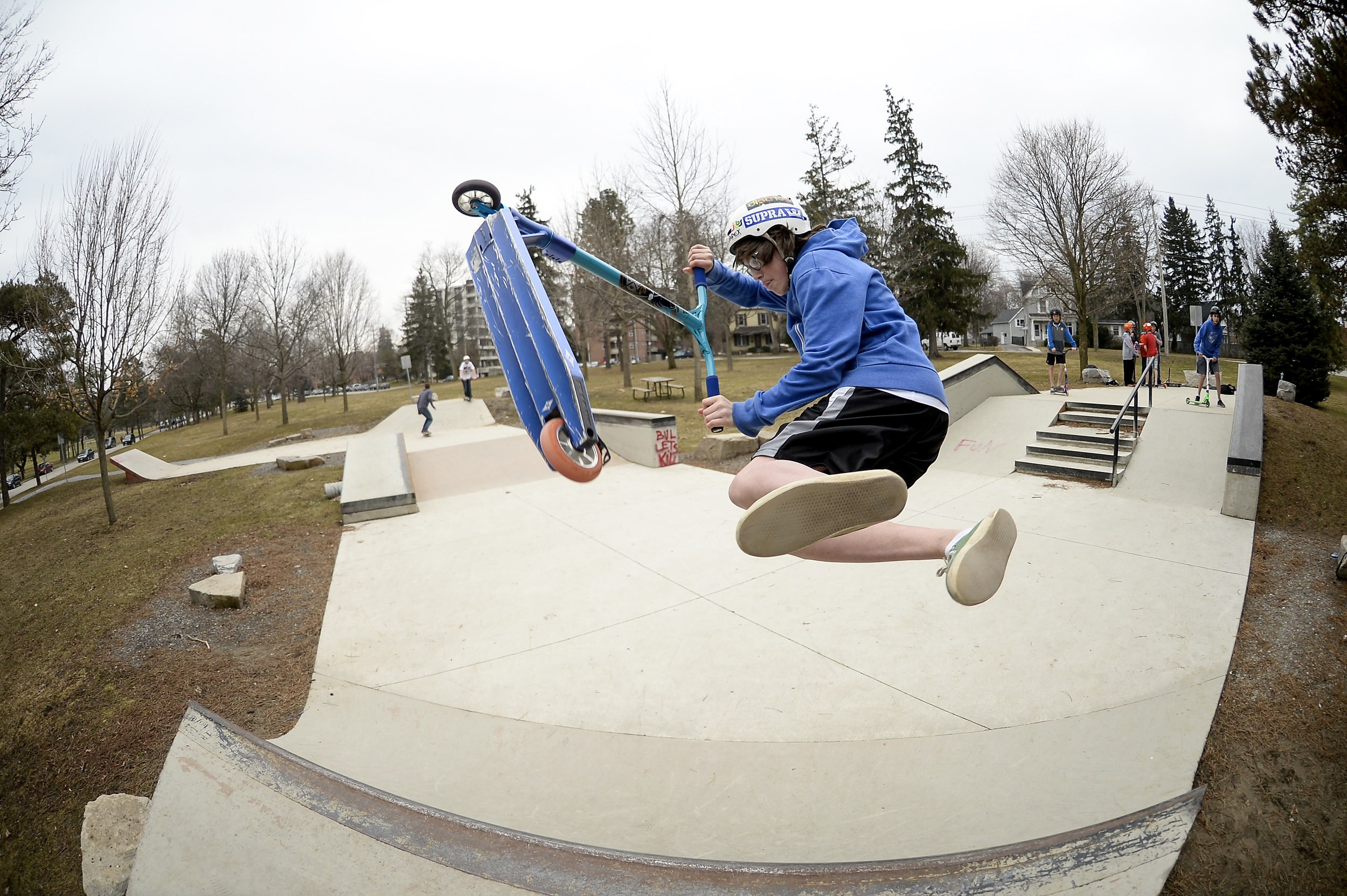Taylor Blair, 14, performs a bri flip at the skate park in Springbank Park in London, Ont. on Friday April 3, 2015. Warm weather and a holiday brought lots of kids out to the park to ride.