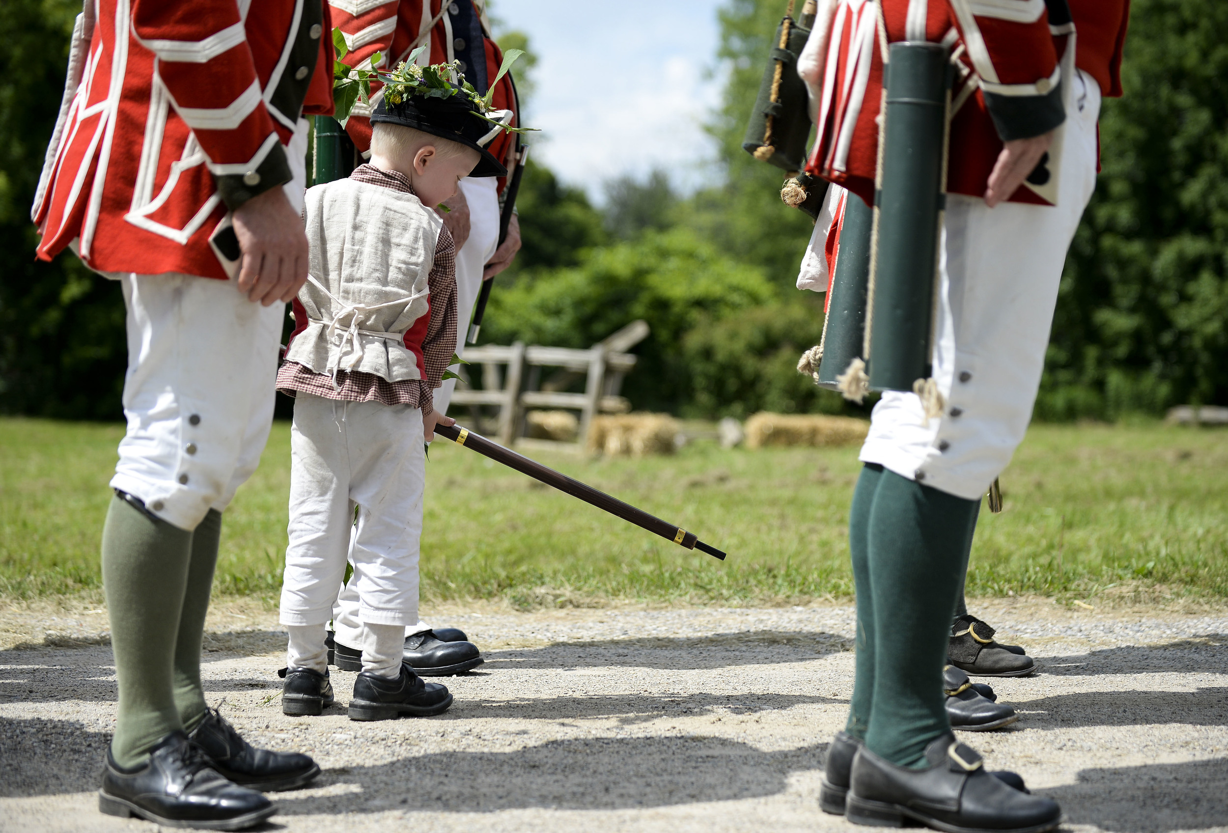 A young boy plays with his gun after a revolutionary war re-enactment at Black Creek Pioneer Village on Sunday afternoon.
