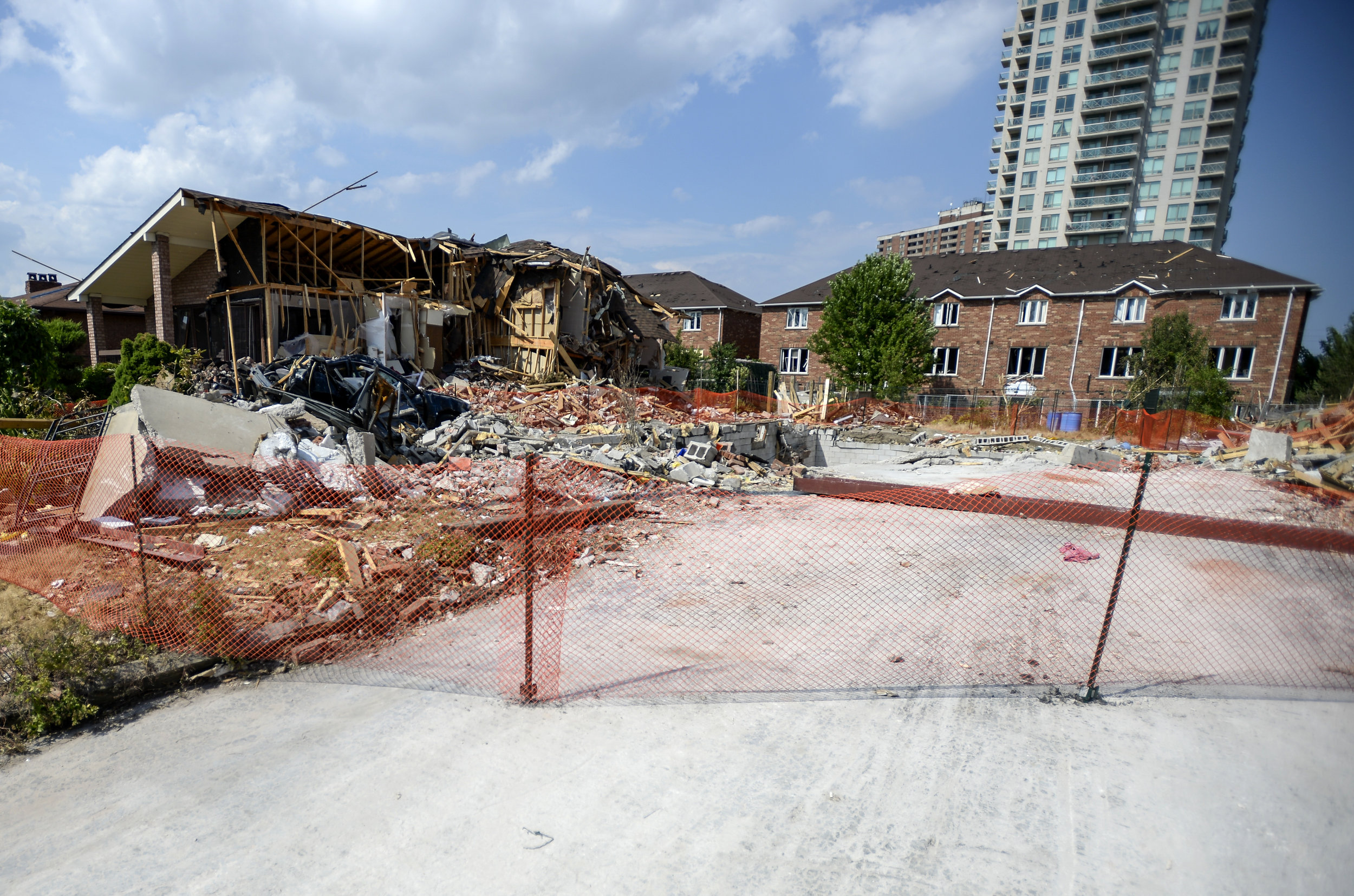 Ground zero. The home that exploded early last week is reduced to a hole in the ground. Mayor Bonnie Crombie and Fire Chief Tim Beckett give a tour of the explosion site on Hickory Dr. on July 6, 2016.