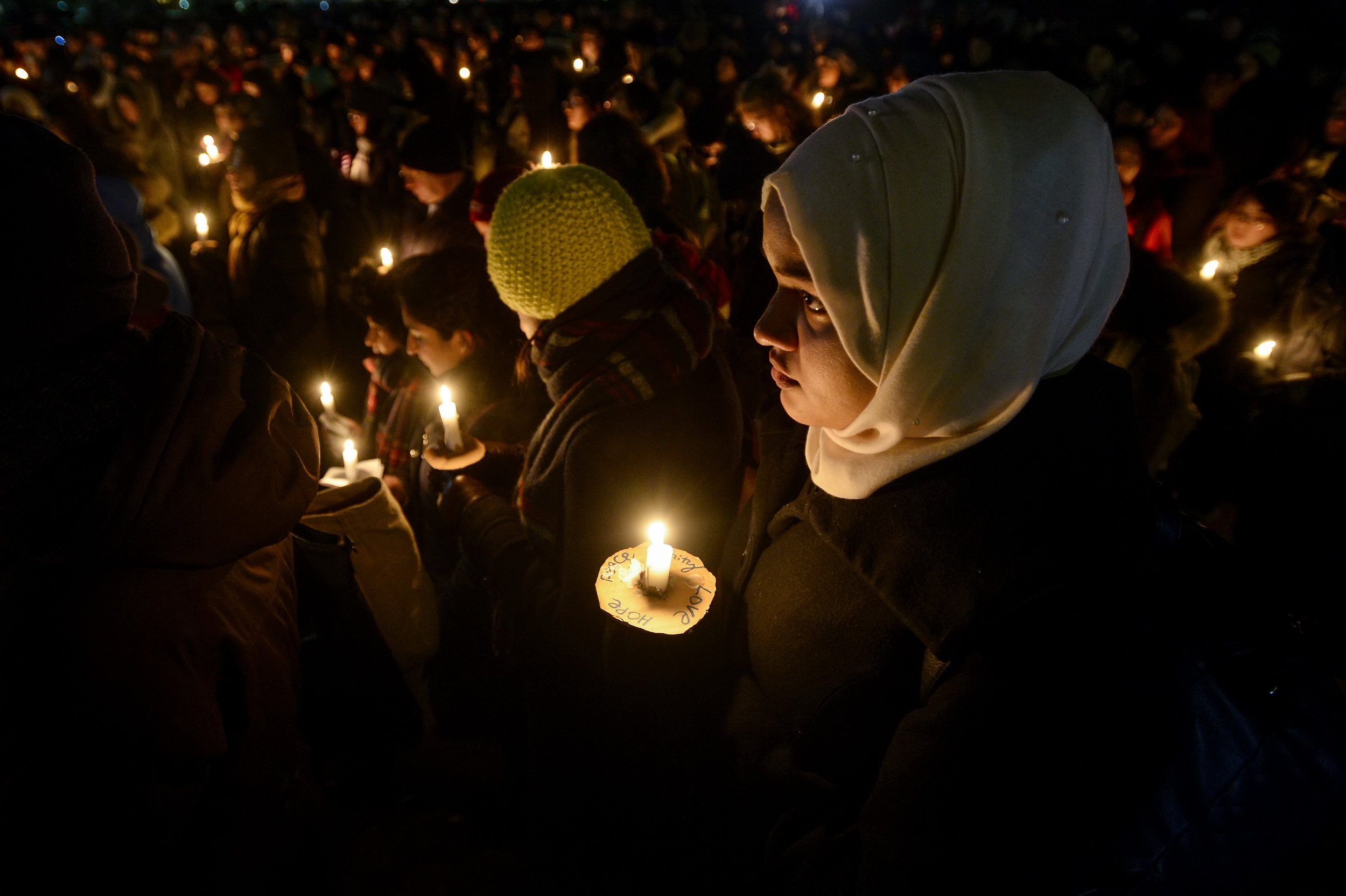 Noshin Chowdhury, 19, listens to a spoken word artist during a vigil held at the University of Toronto for the 6 victims killed after a shooting at a Quebec City mosque. Hundreds of people gathered at King's College Circle at the University of Toronto on Monday Jan. 20, 2017 to pay respects to those who lost their lives after the deadly shooting.
