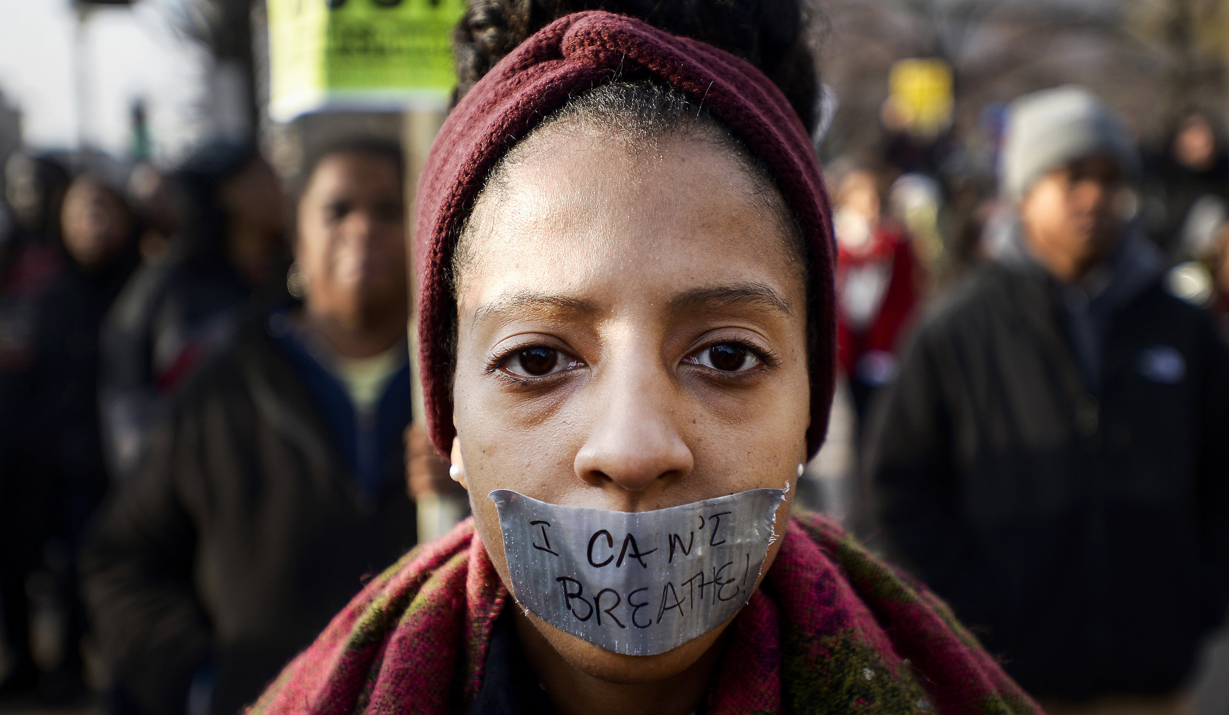 A demonstrator covers her mouth with duct tape in protest of the recent police killings in the United States. Thousands of people rallied in support of the families of Michael Brown and Eric Garner during the Justice for All march in Washington, D.C. on Dec. 13, 2014.