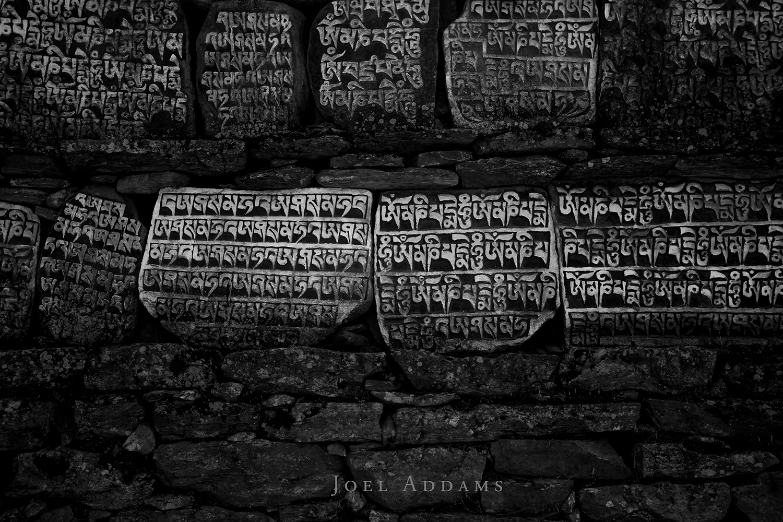 The ubiquitous mani stones. Photo by Joel Addams