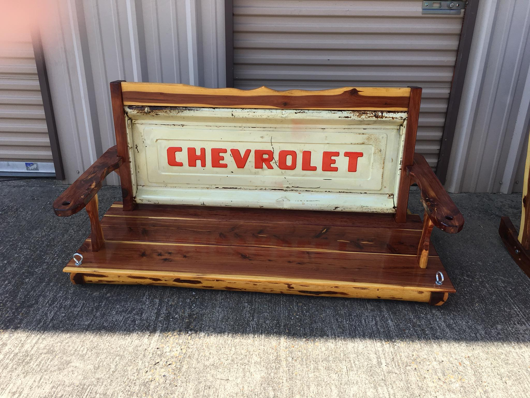 Custom Cedar porch swing with Chevrolet tailgate. Built by Red Cedar Creations Steve Coleman