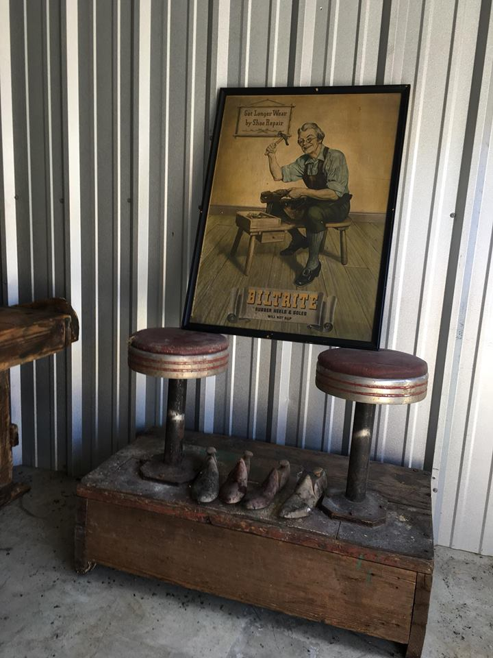 Original Shoe Shine stand from the cell barn in El Dorado, Kansas Cobbler molds & Vintage posters