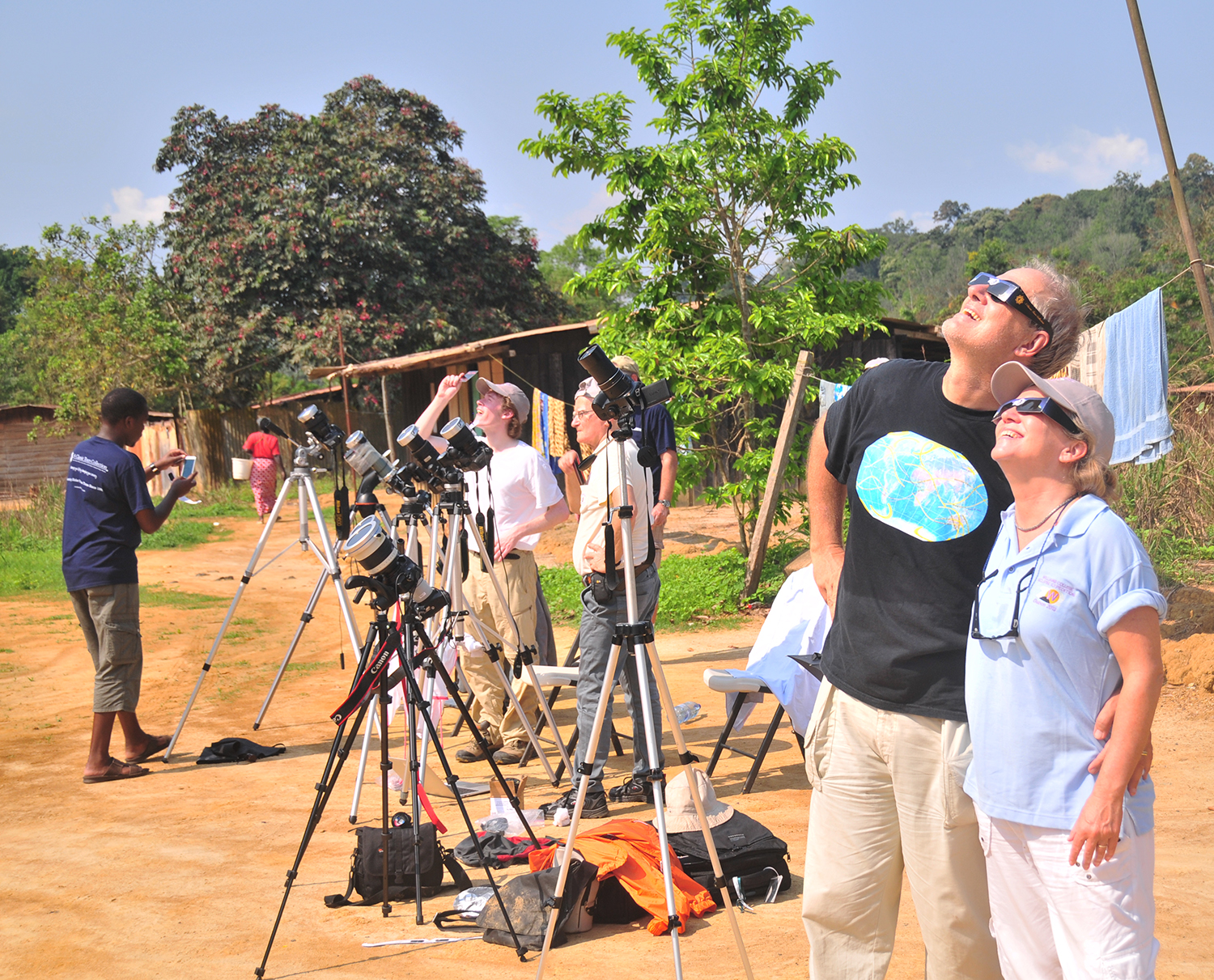 Safely viewing the partial phase of the solar eclipse with eclipse glasses in Gabon, Africa, November 2013. @2013 Michael Zeiler.