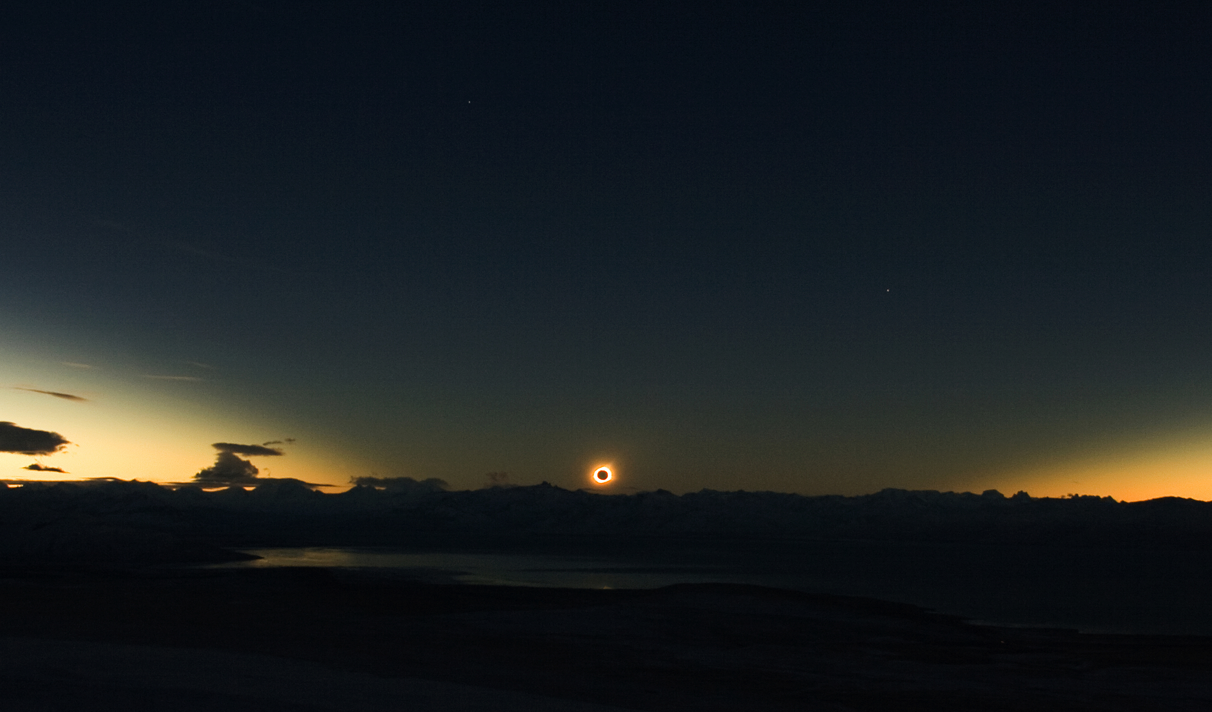 SUNSET TOTAL SOLAR ECLIPSE AT EL CALAFATE, ARGENTINA ON JULY 11, 2010. © 2010 LUKAS GORNISIEWICZ & DAVID MAKEPEACE