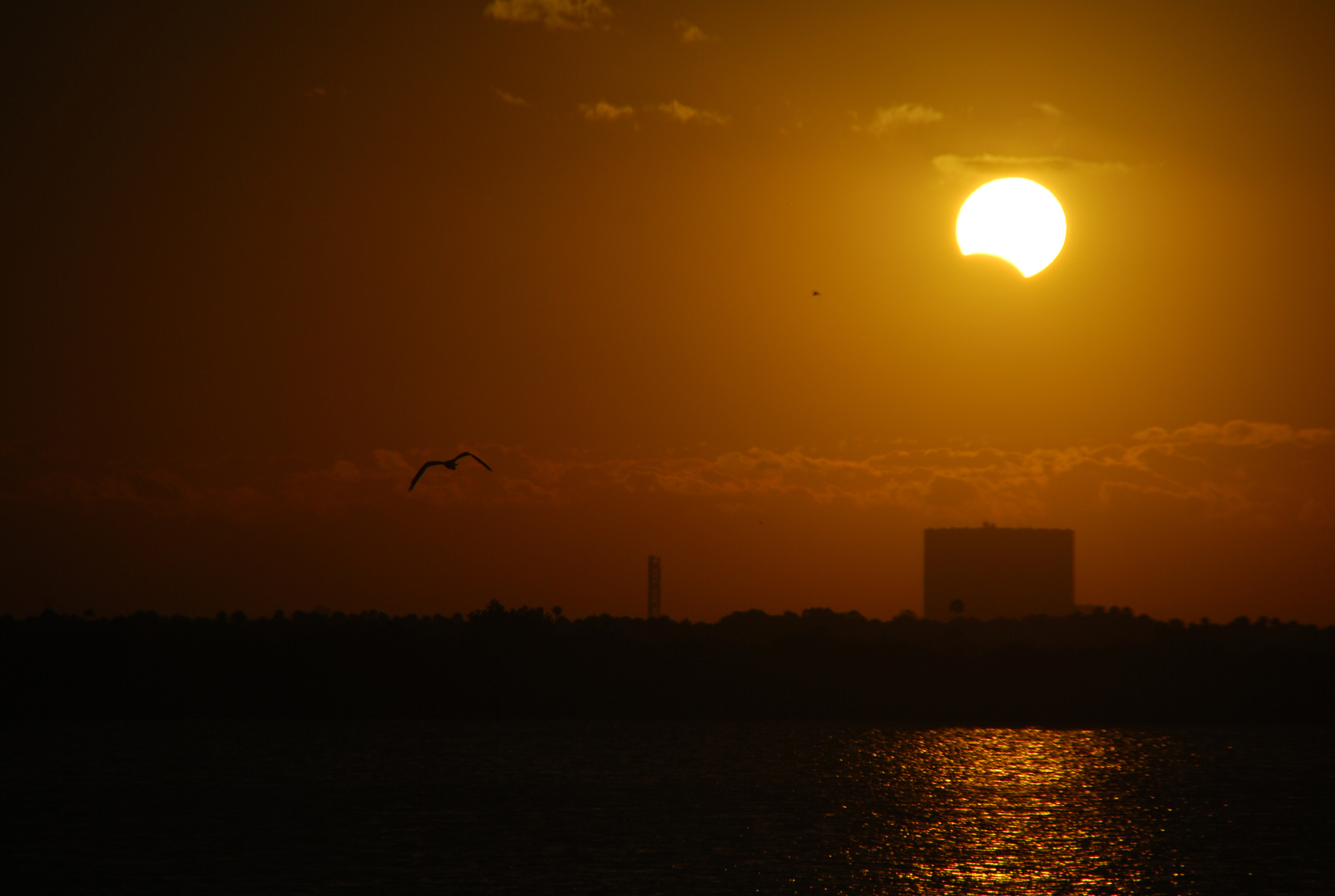 Partial eclipse over the Vehicle Assembly Building at the Kennedy Space Center. Copyright David Dickinson, November 3, 2013