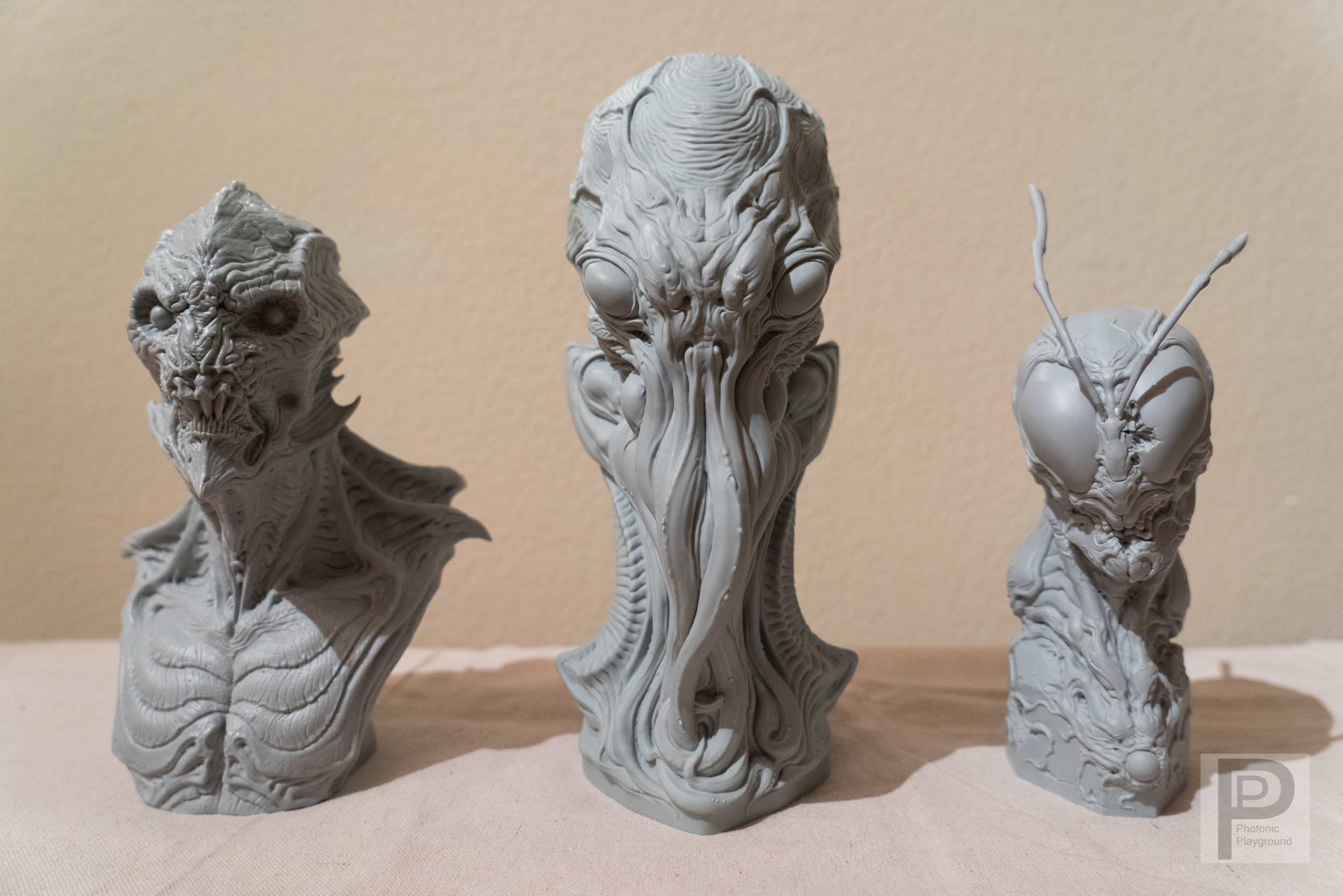 Gillman, Cthulhu and Hopper busts by Dominic Qwek in scale comparison together (front)