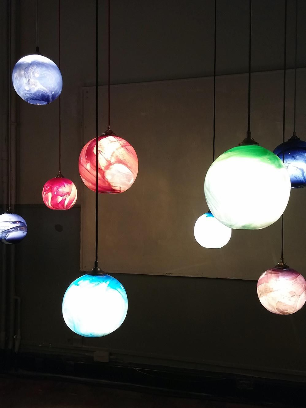 Mineral Pendants by  Rothschild & Bickers  created beautiful natural patterns through masterful glassblowing.