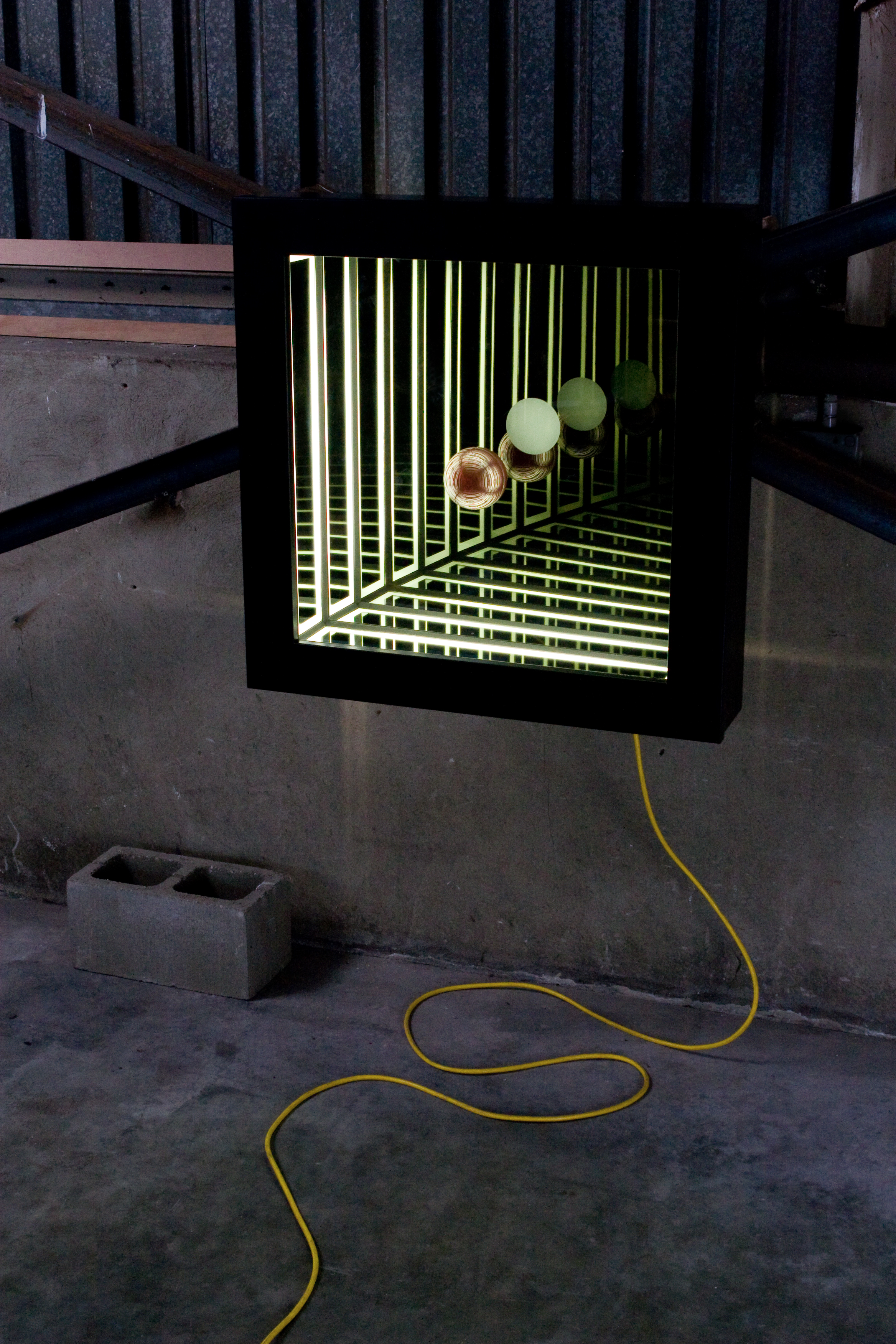 Present in Absence , wood, reflective glass, mirror, blown glass and fluorescent lights, 82 x 82 x 17cm. Photo: Pippy Mount.