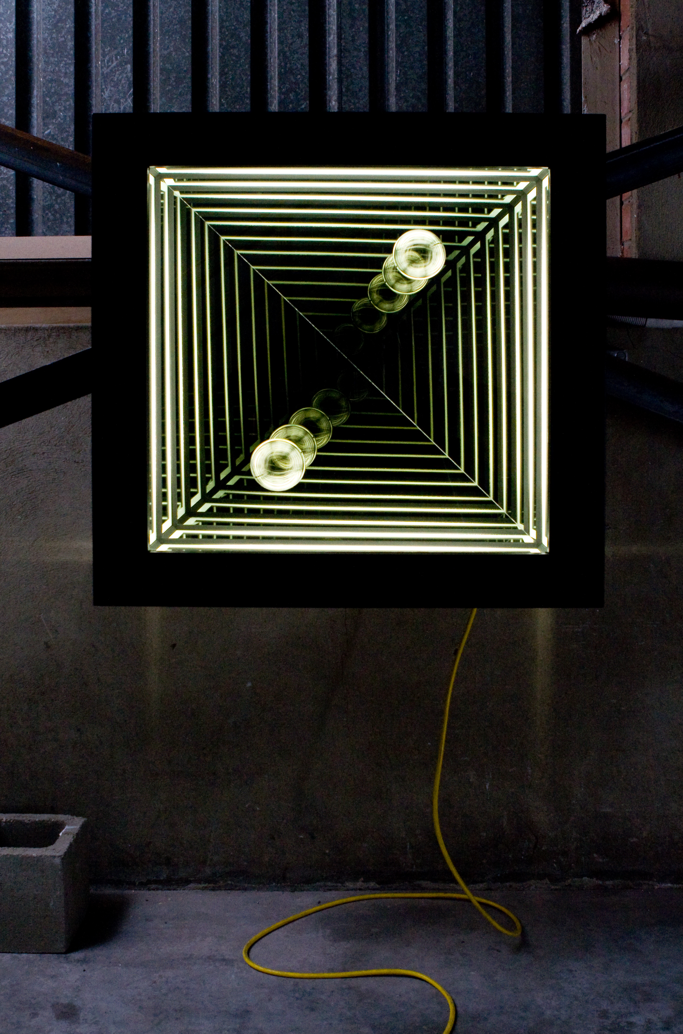 Passing III , wood, reflective glass, mirror, blown glass and fluorescent lights, 82 x 82 x 17cm. Photo: Pippy Mount.