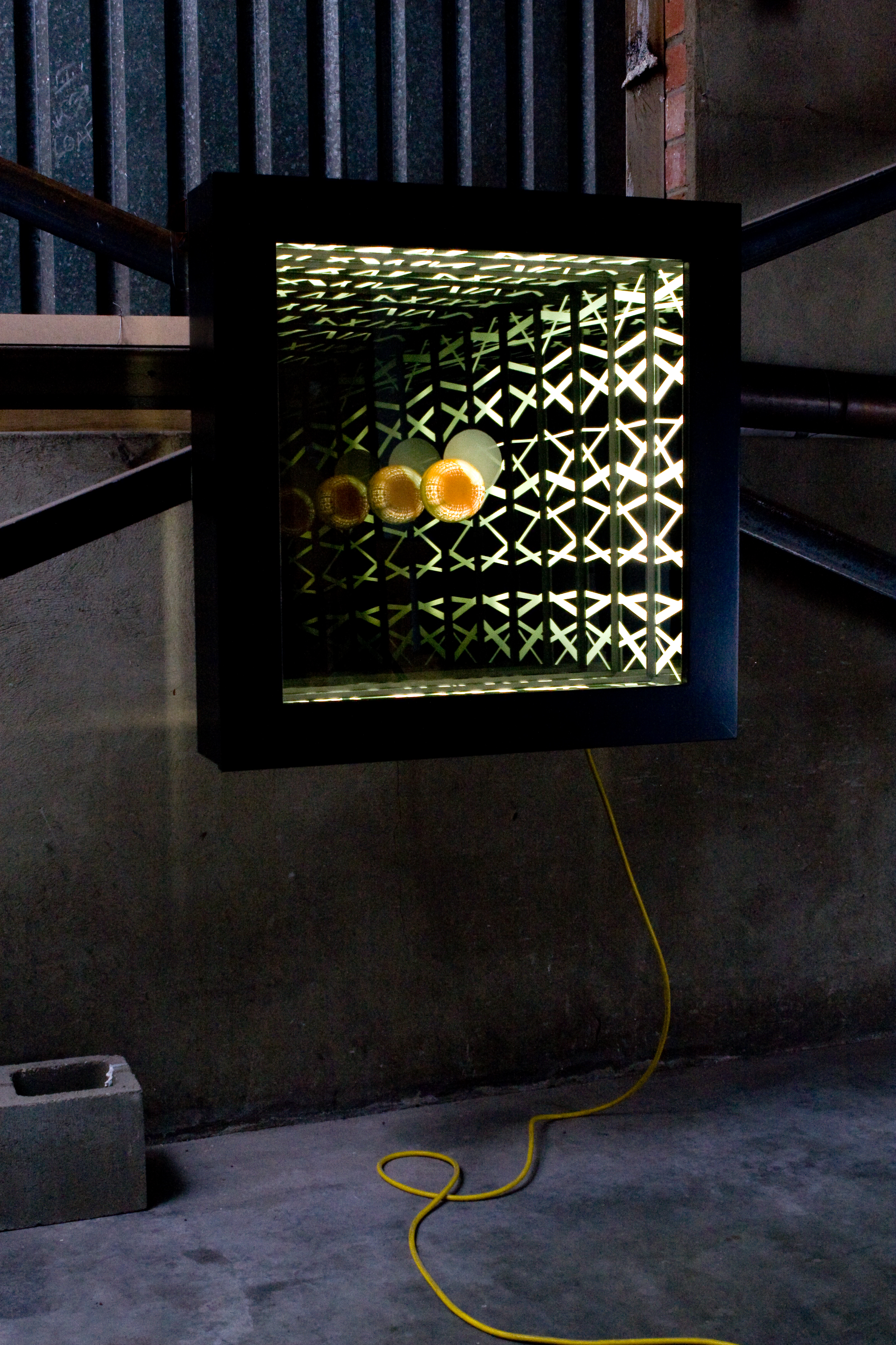 Absence Consuming , wood, reflective glass, mirror, blown glass and fluorescent lights, 82 x 82 x 17cm. Photo: Pippy Mount.