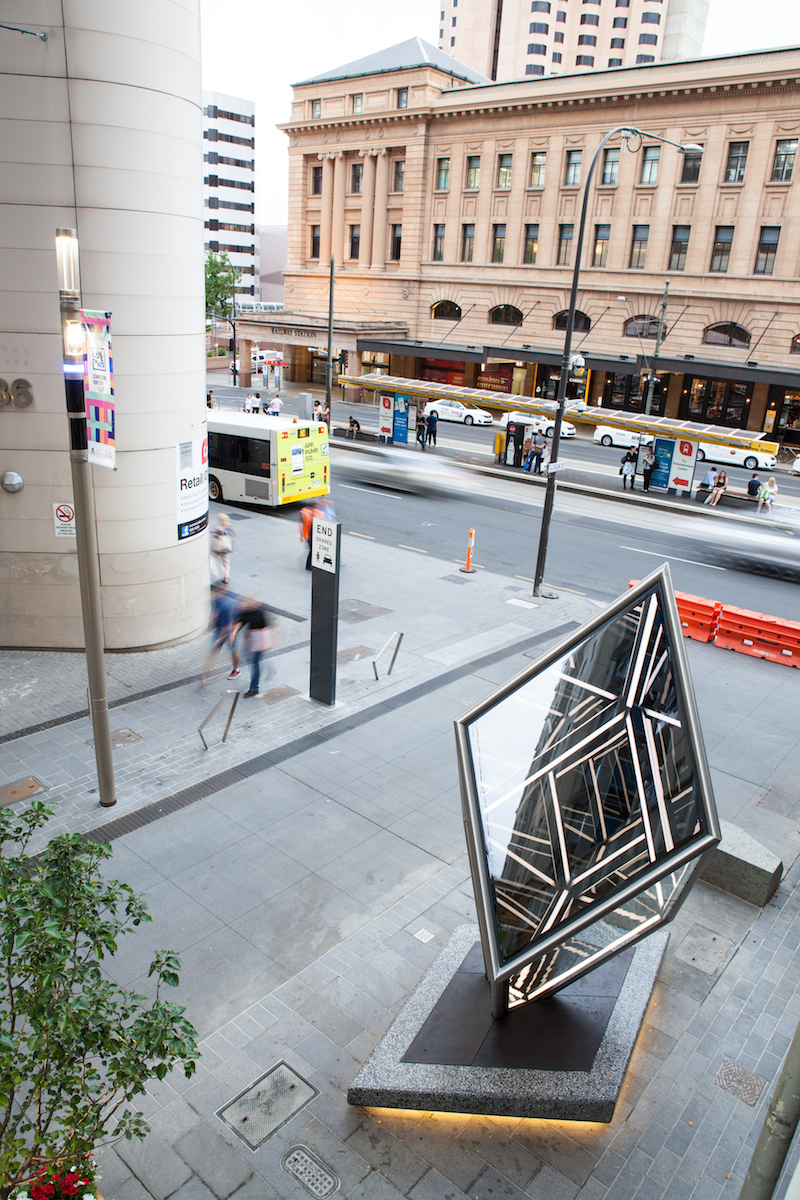 Golden Rhombohedron (acute),  2017 , s tainless steel, reflective glass, polished concrete and LED lighting ,  450 x 220 x 330cm (including plinth) .  Commissioned by Adelaide City Council and Renew Adelaide for the Market to Riverbank link, Bank Street, Adelaide. Photo: Pippy Mount.