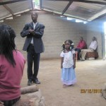 SURVIVING TWIN WITH HER FATHER AT YAHWEH'S CHAPEL