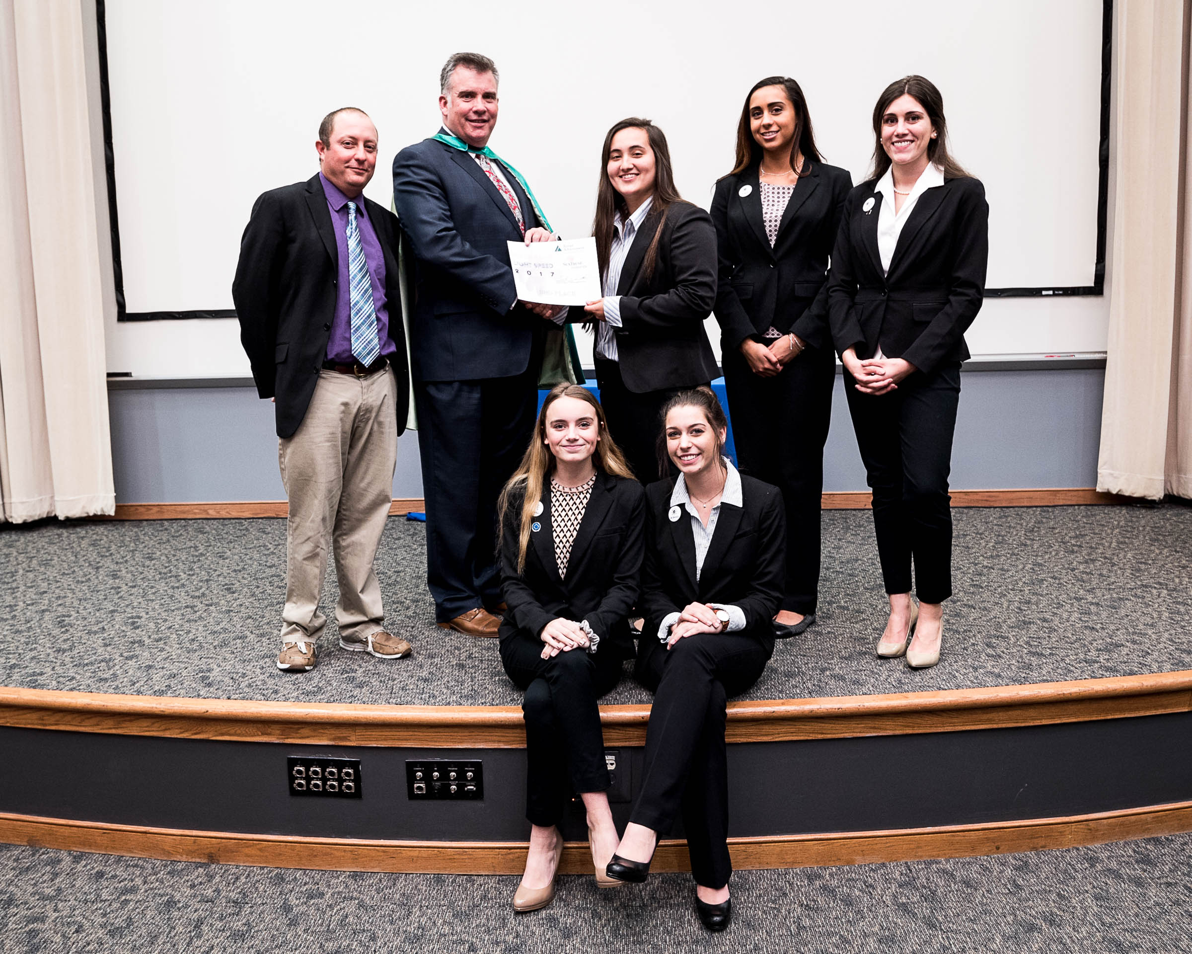 VB Pockets of Kellam High School was First Runner Up and won Best Annual Report and Best Commercial (Pictured with teacher Jason Copeland and JA President Frank E. Hughlett).
