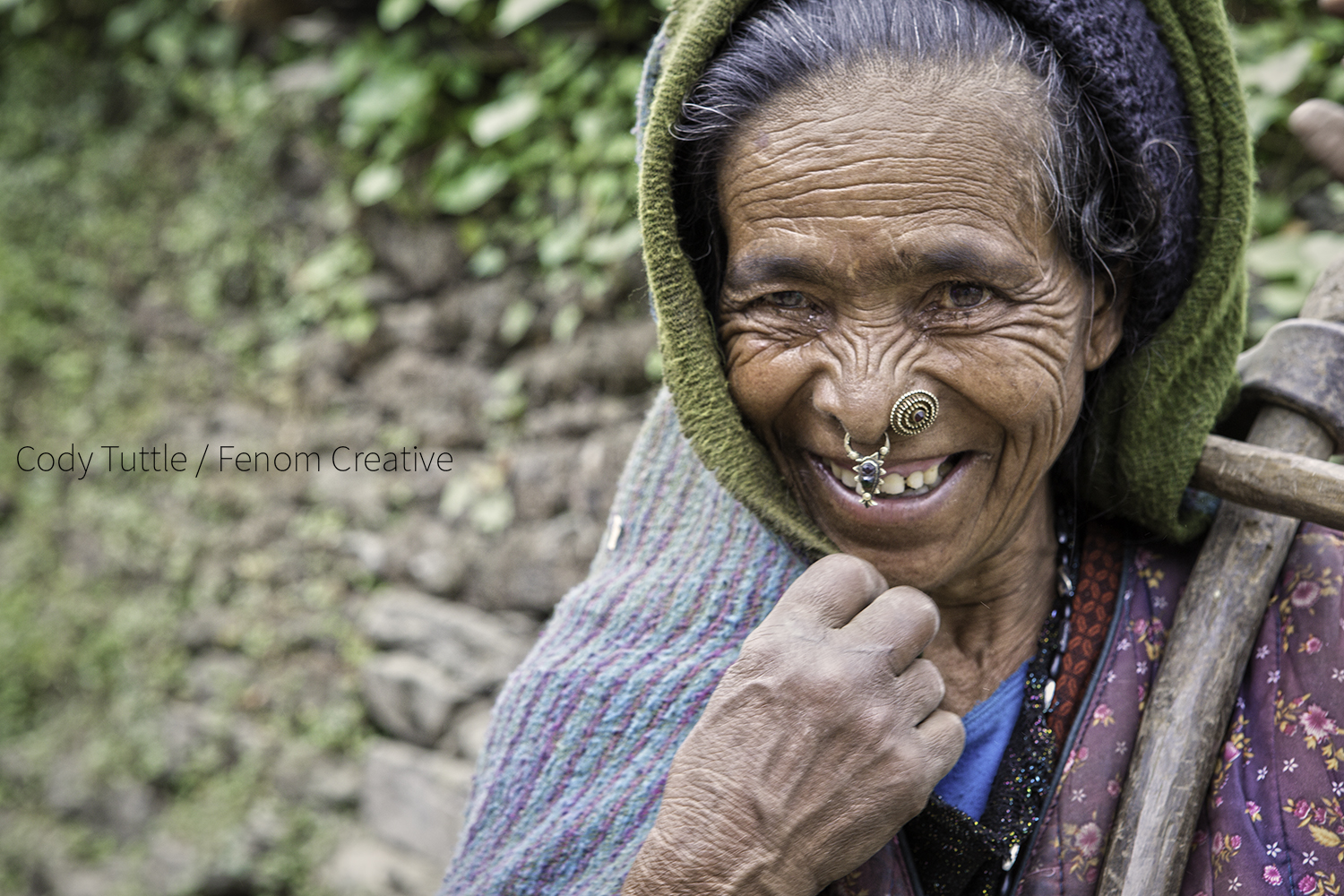 Nepali woman outside the village of Barpak share her joy in the midst of total destruction. Photo: Cody Tuttle