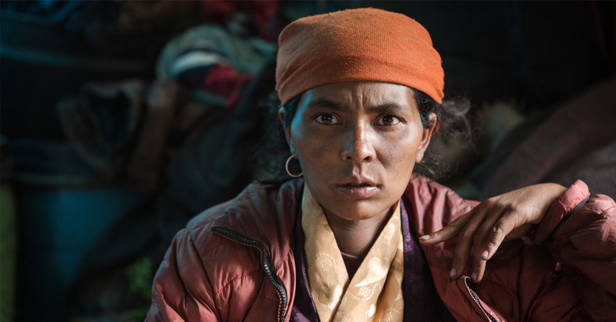 Pema's wife watches as her husband is carried off to seek medical attention in Kathmandu. She is 8 months pregnant with her 6th child and doesn't know if or when she will see her husband again.