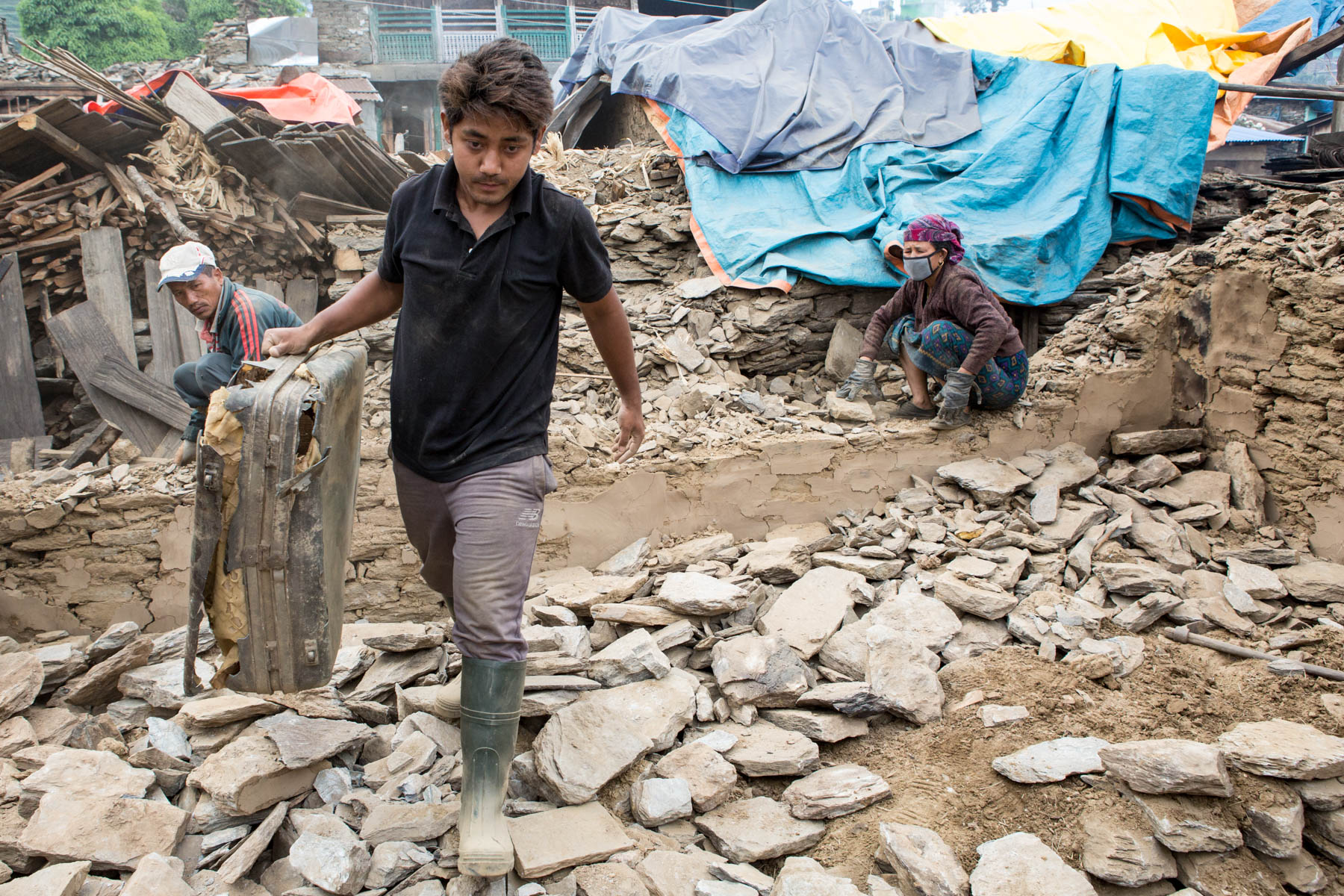The people of Barpak sort through the rubble of what once was their home after the April 25th earthquake devastated the area.