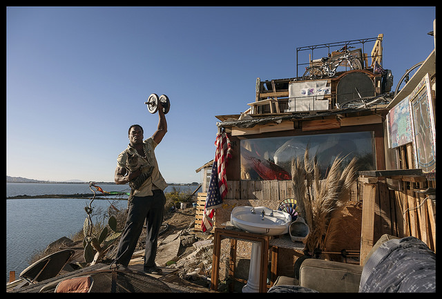 """""""Boxer Bob with Sugar Ray at Landfill Mansion"""" 32 x 50 inch archival ink jet photograph by Robin Lasser, 2014"""
