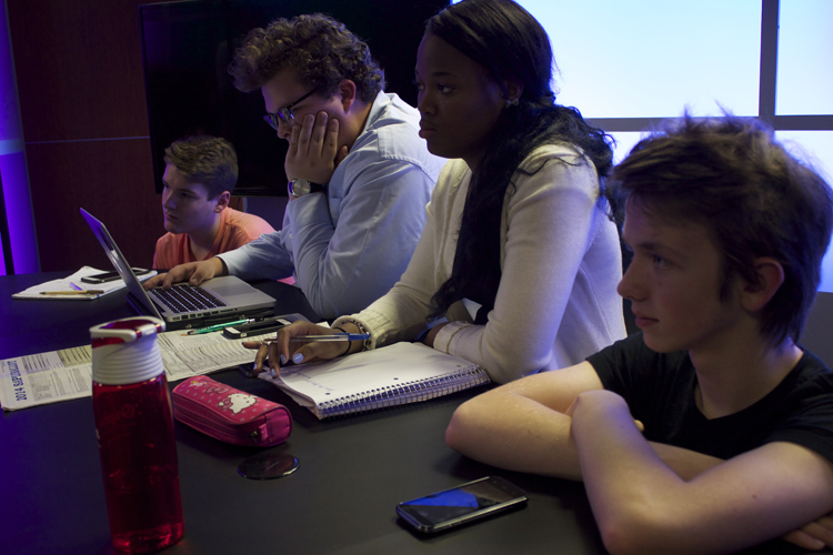 From left, US House anchor producer Bryan Scott, Mayers, local races anchor producer Ericka Garrison and US Senate anchor producer Elijah Bienz listen in as Mrs. Dunning explains important information about the 2014 election.
