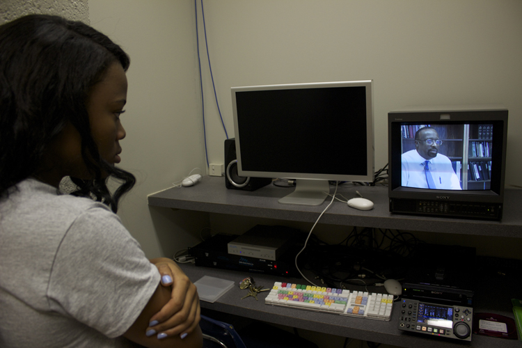 Each of the show's anchor producers are also responsible for producing a report. Local races anchor producer Ericka Garrison looks over an interview she conducted with respected journalists and University of Memphis professor Otis Sanford.