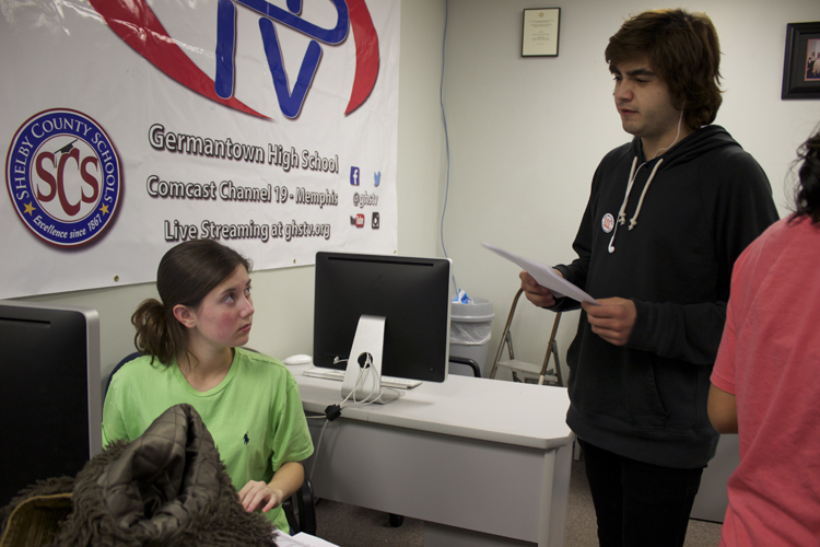 Jaramillo goes over report specifics with reporter and US House anchor Hayley Bardos.