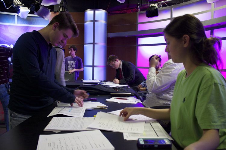 Bryan Scott goes over details for some of the US House races Bardos will cover during the rehearsal.