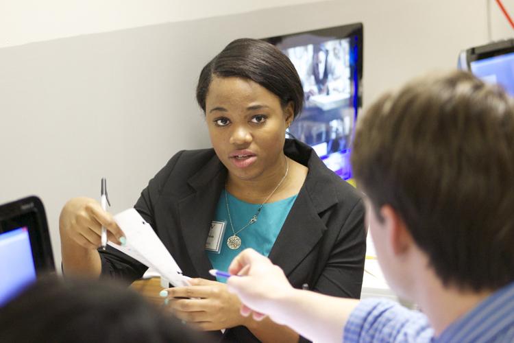 Local anchor producer Ericka Garrison prepares a results sheet for data entry producer Connor Sackett.