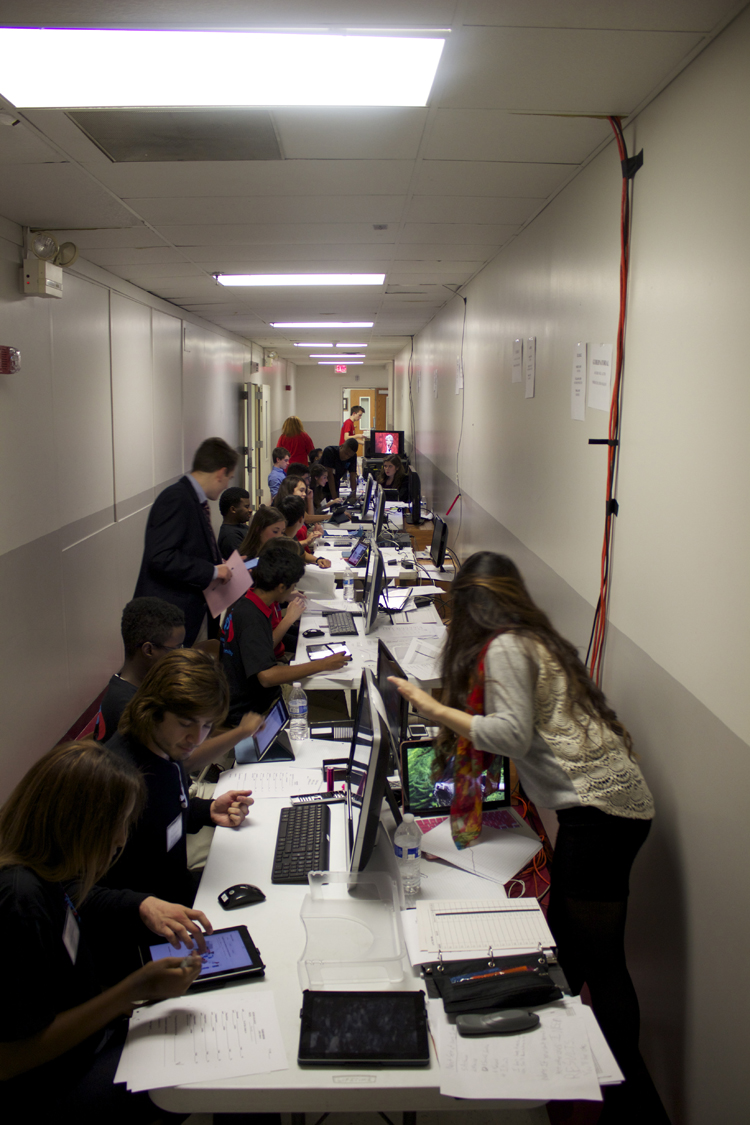 A look down the data entry and research line. Of the numerous aspects of the show that impressed guests Tuesday night, the action in this hallway may have topped the list.