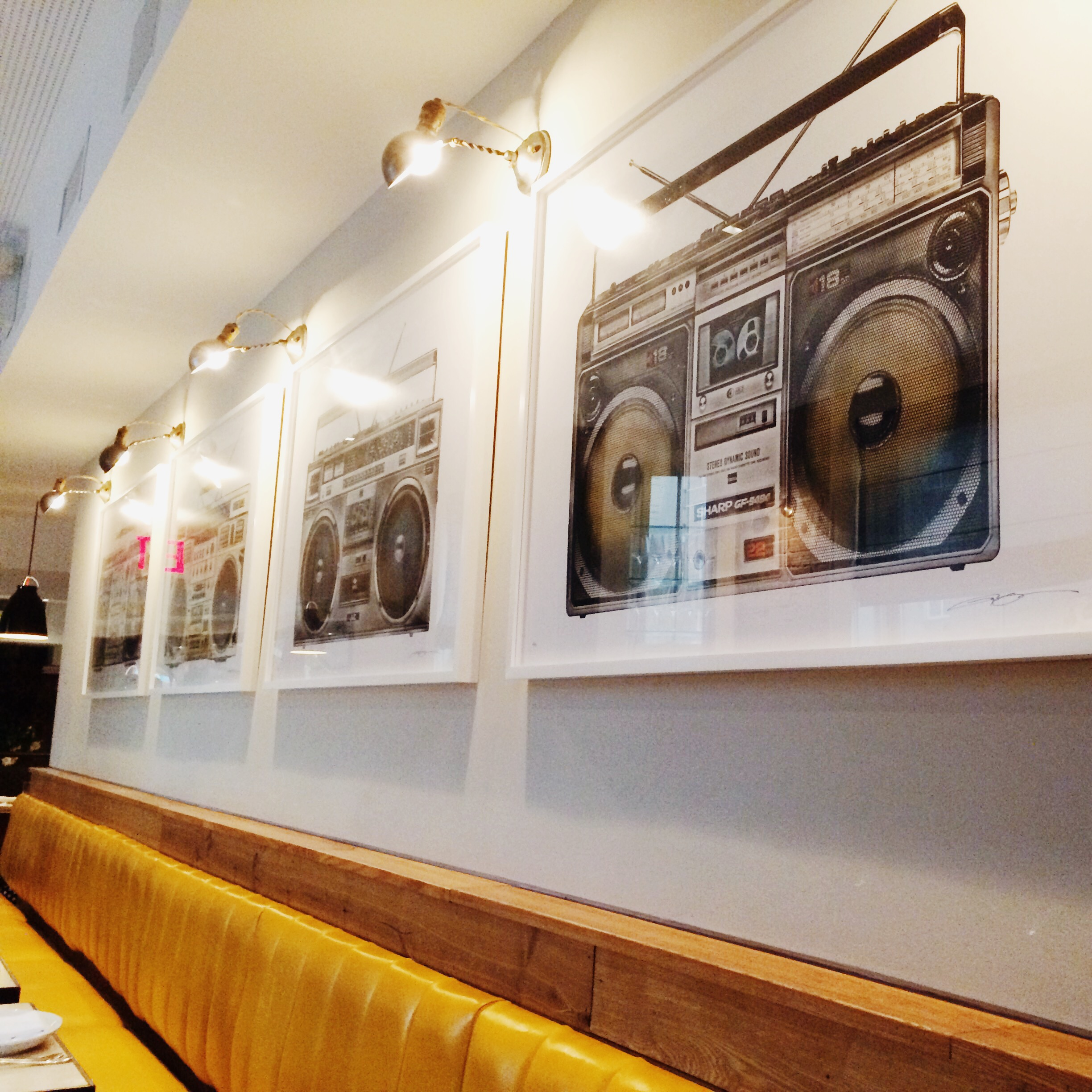 Lyle Owerko Boombox Project originals adorn the walls at CB
